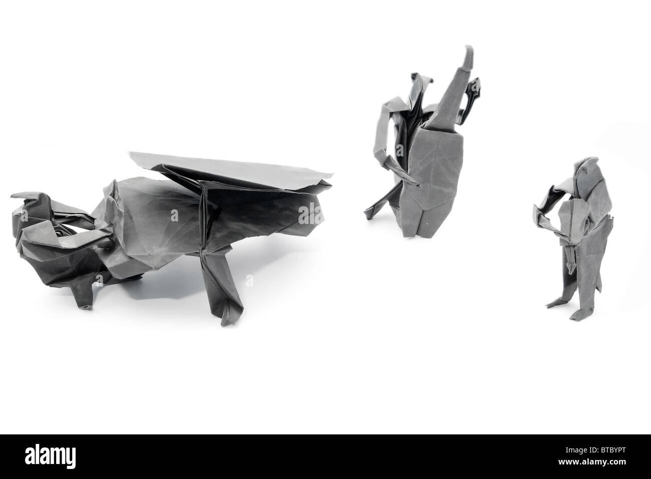 Origami Set bestehend aus Musikern wie Pianisten Geiger und Cellisten Stockbild
