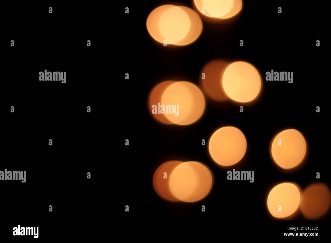 Abstrakte Lichter erschossen hautnah auf einem schwarzen Hintergrund Stockbild