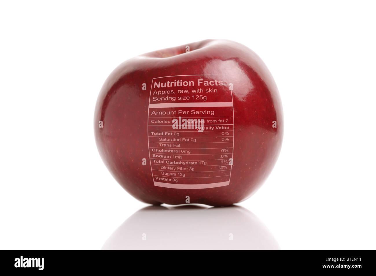 Apfel mit Nährwertangaben Stockbild