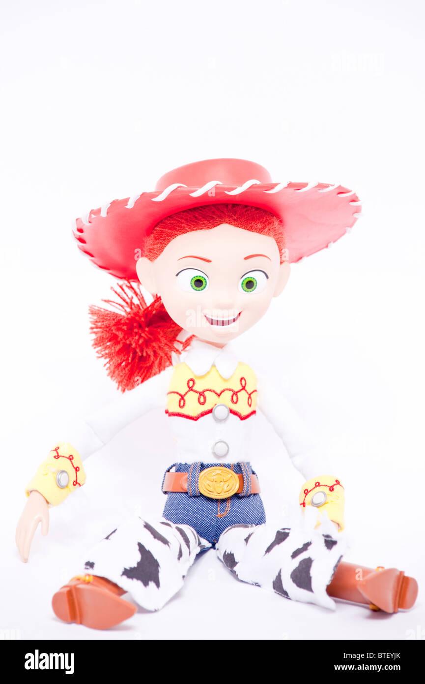 Eine Nahaufnahme Foto von Kinder Spielzeug Jessie Charakter aus den Toy Story Filmen vor einem weißen Hintergrund Stockbild