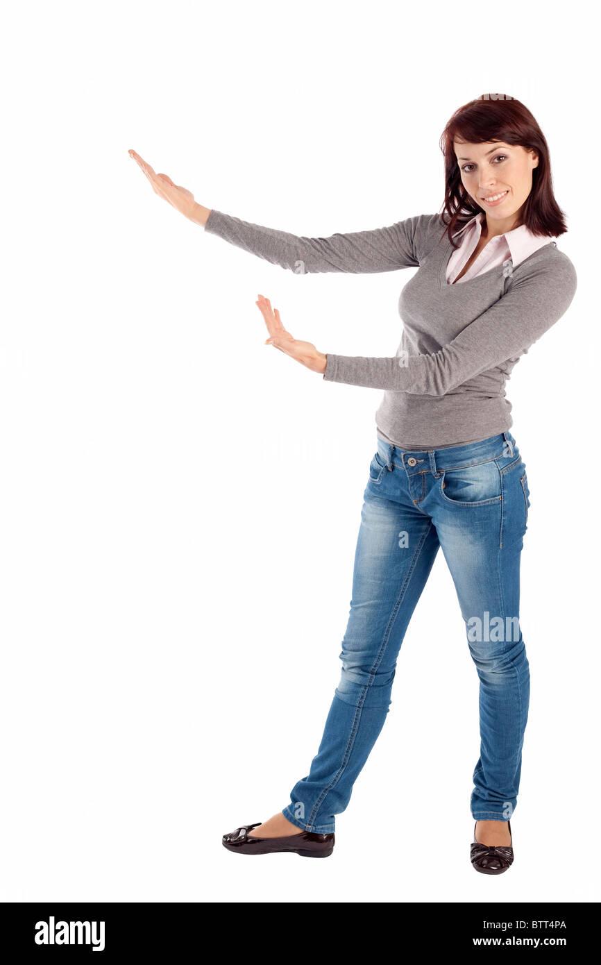 Junge Frau in Freizeitkleidung, Pose, isoliert auf weißem Hintergrund präsentiert. Stockbild