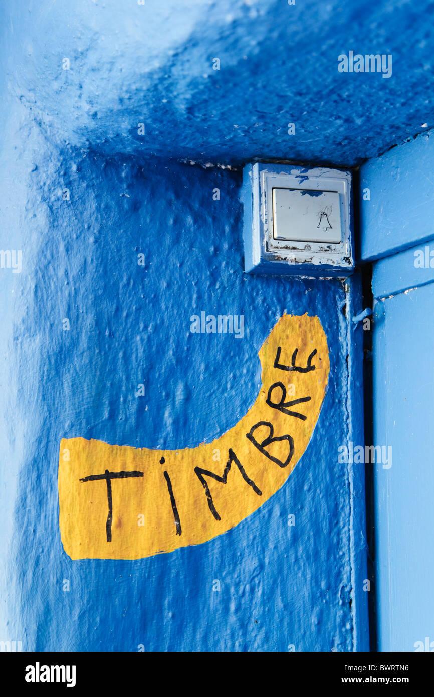 Handgemaltes Schild in spanischer Sprache auf Glocke Stockbild