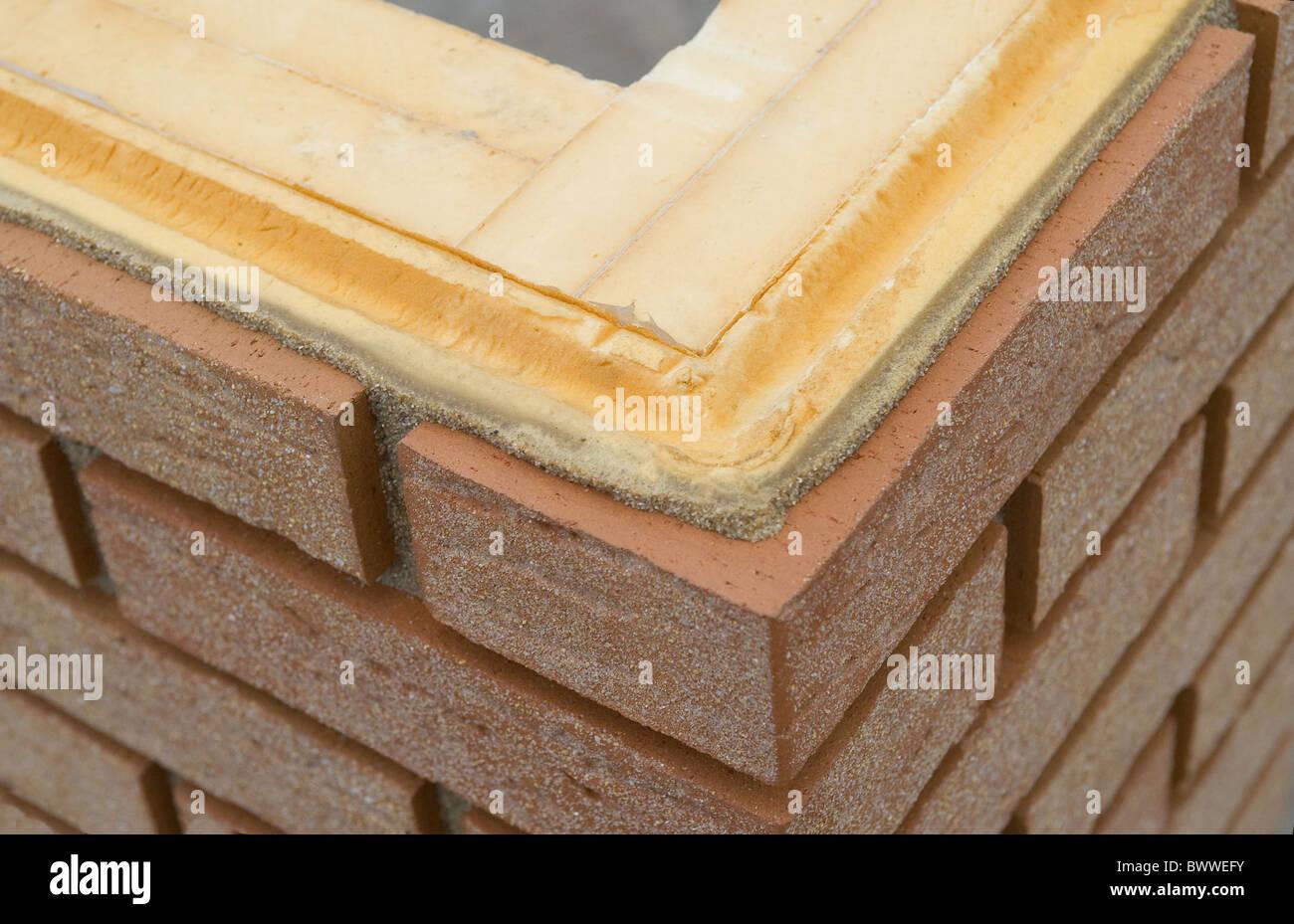 Wärmedämmung von einem brickwall Stockbild