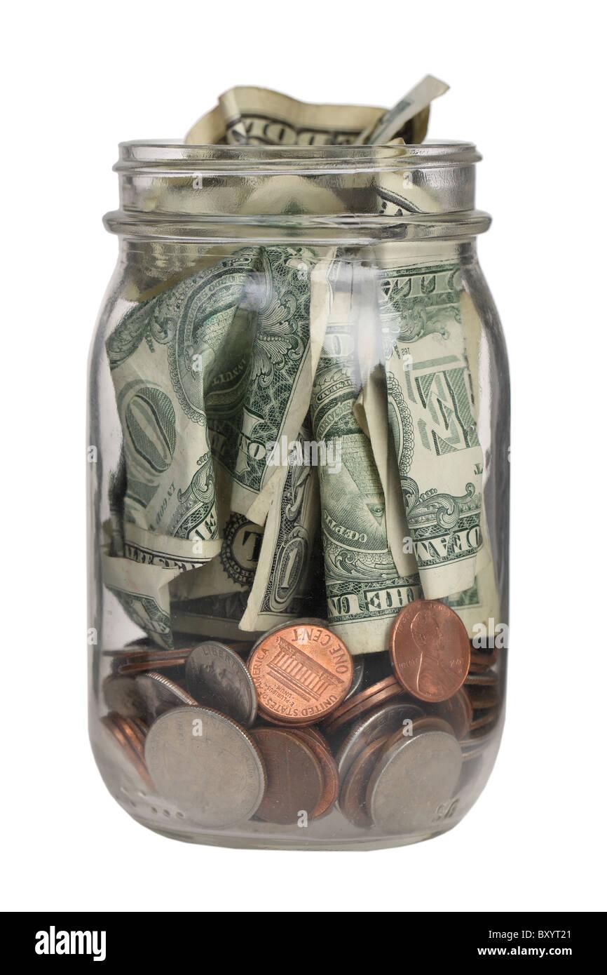 Glas voll Geld auf weißem Hintergrund Stockbild