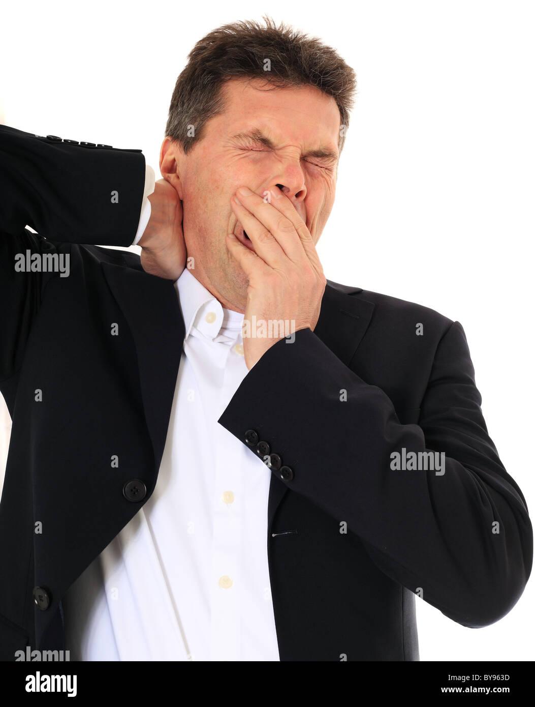 Müde Mann mittleren Alters. Alle auf weißem Hintergrund. Stockbild