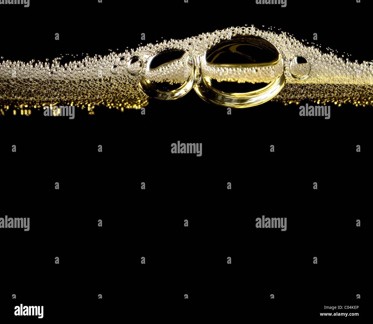 Nahaufnahme von Bubbles Champagner Stockbild