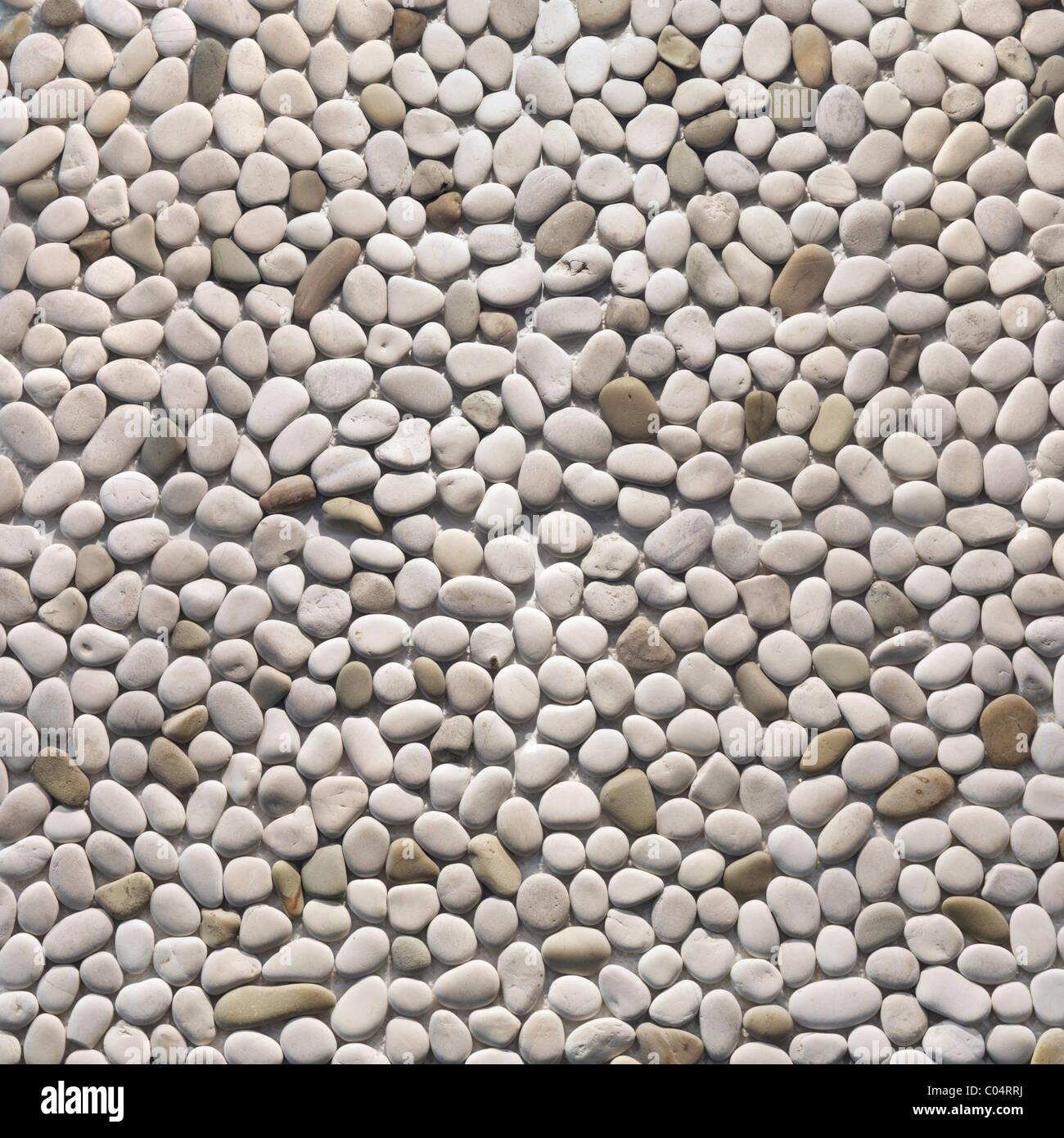 Elfenbein Kieselsteine Textur Hintergrund. Pebblestone Stein innen und außen Stockbild
