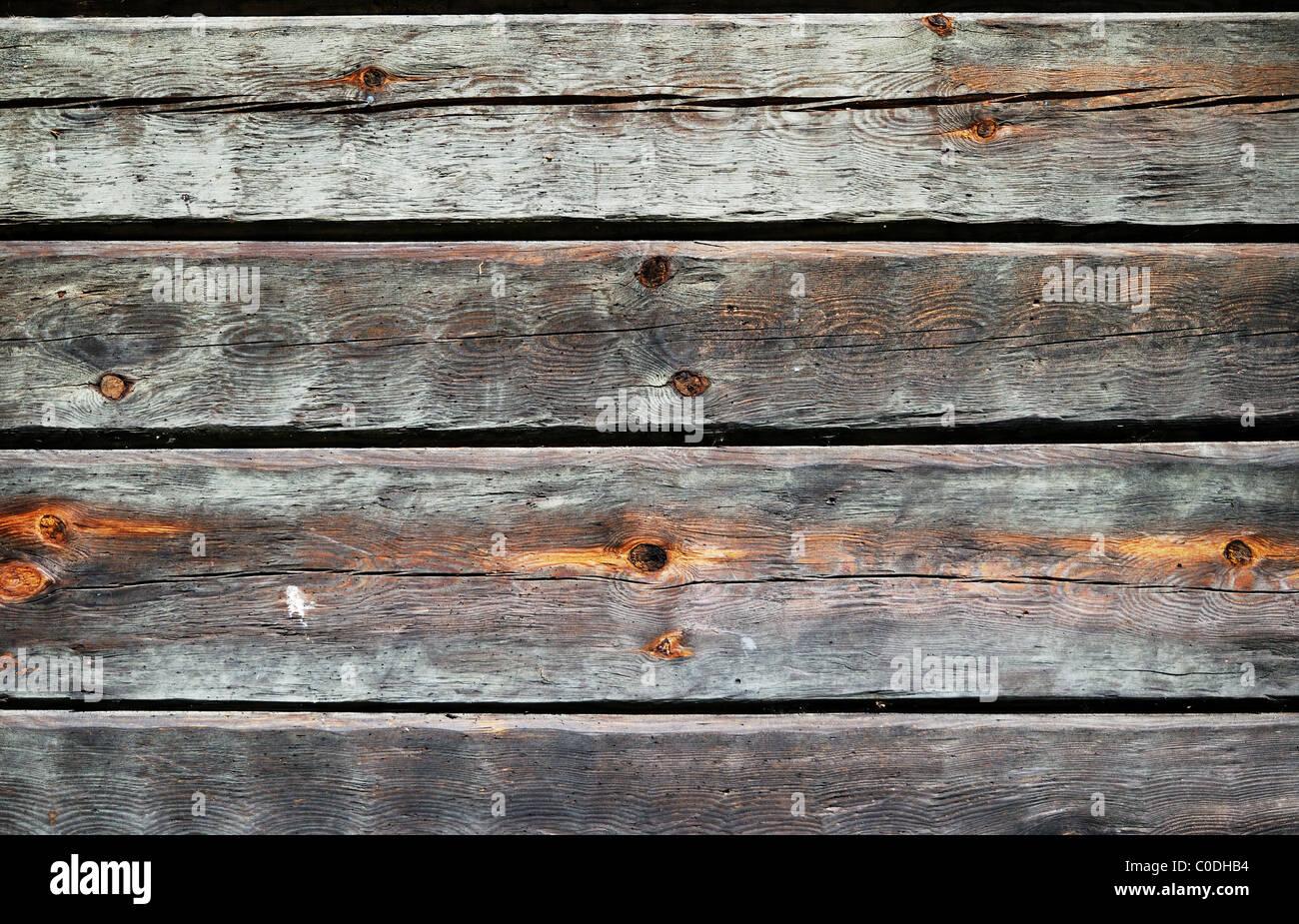 Holzwand des alten Holzhauses Stockbild