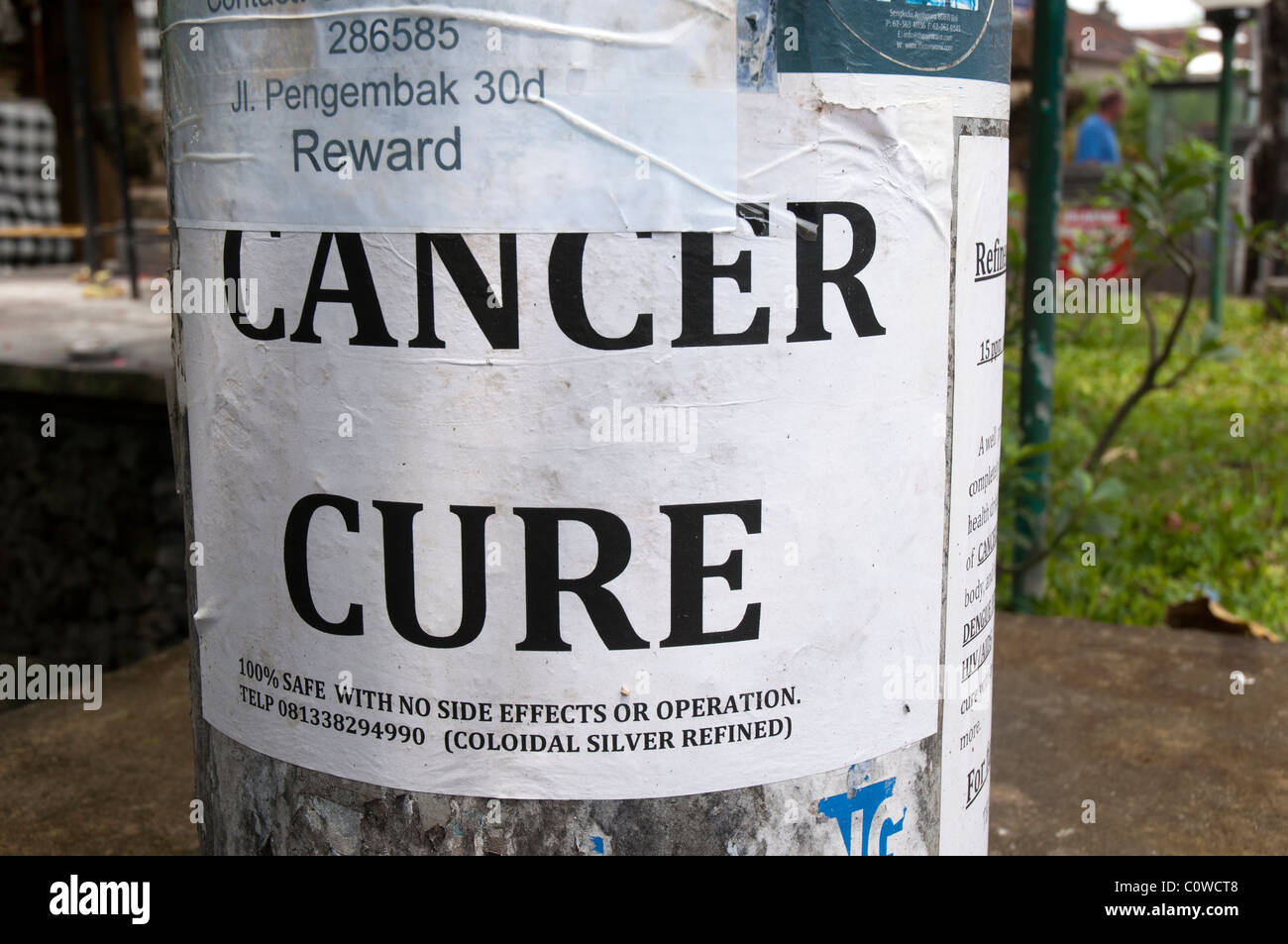 Plakat für eine Heilung von Krebs in Bali, Indonesien Stockbild