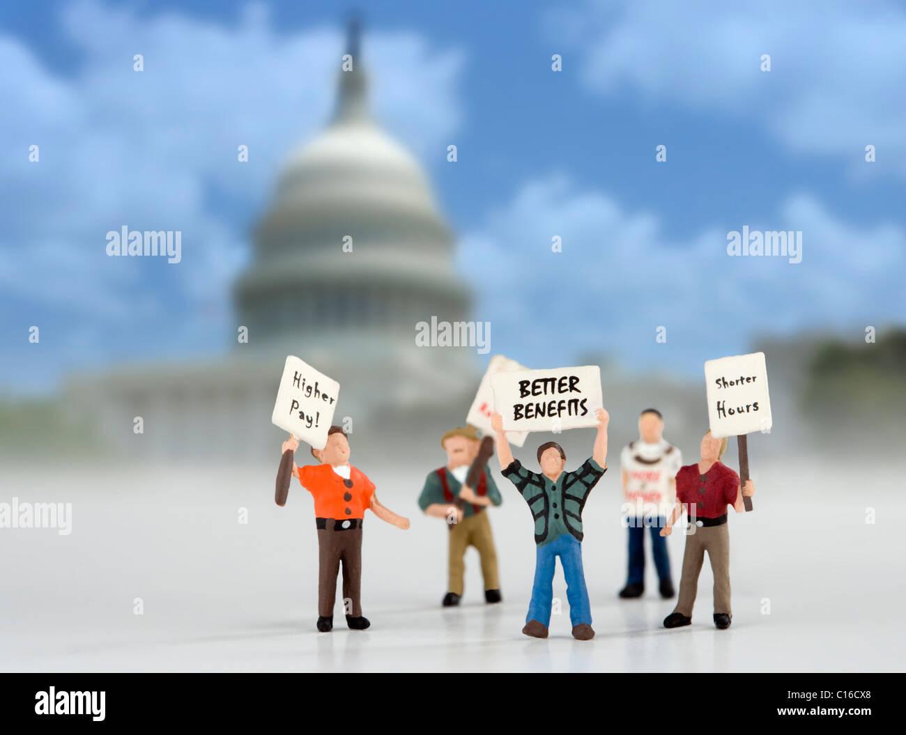 Demonstranten auf das Capital Building-Konzept-Bild. Modell Figuren Demonstranten in Washington. Stockbild