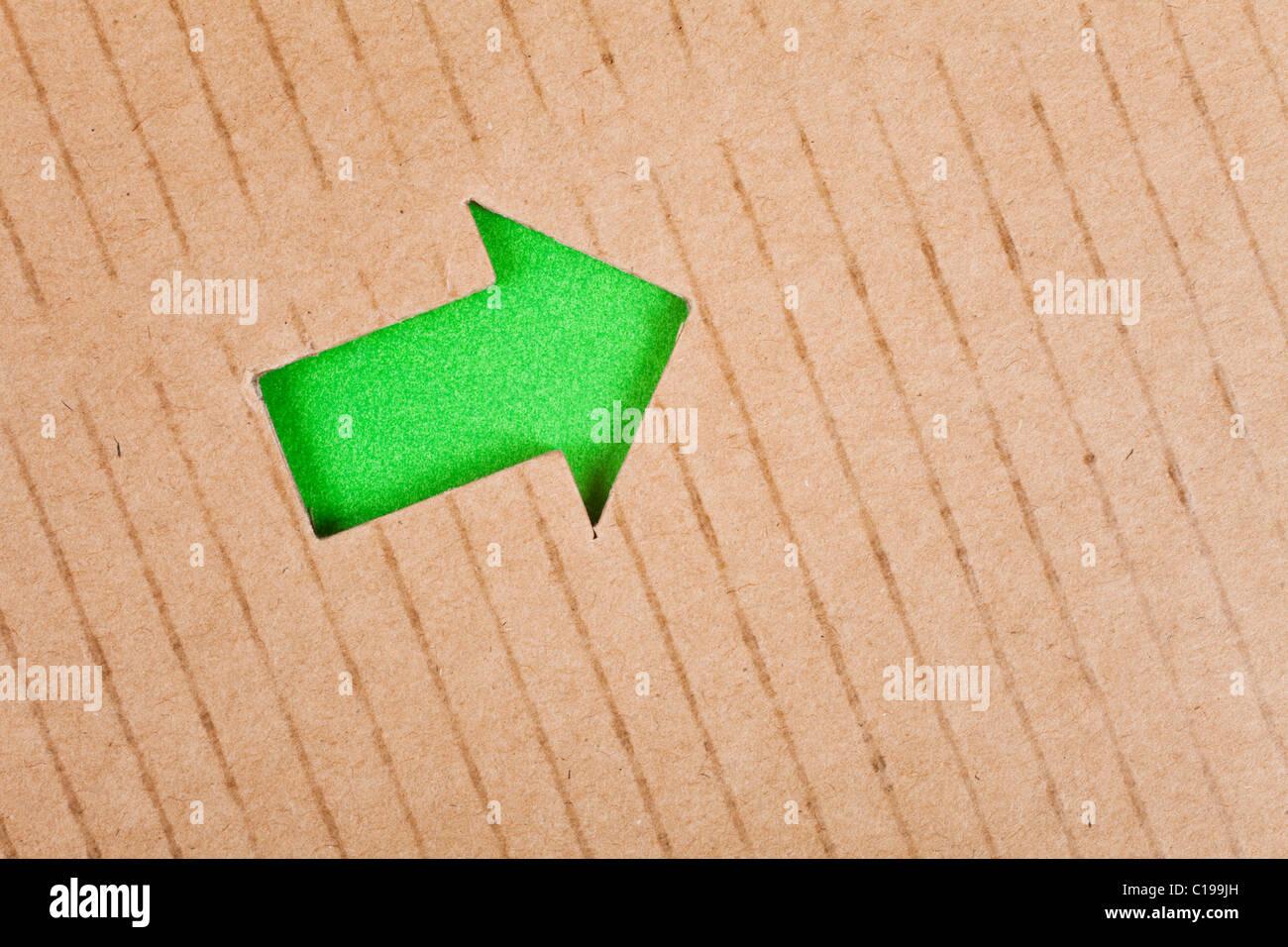Pfeil-Symbol und Pappe für Hintergrund Stockbild