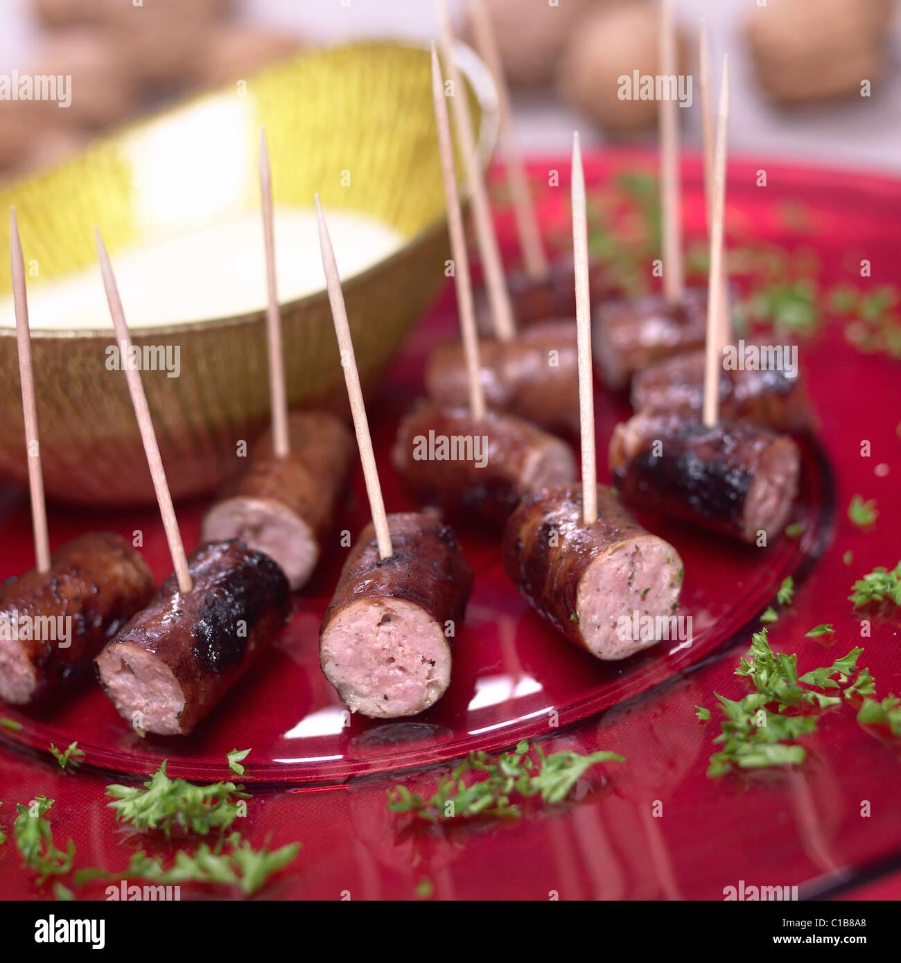 Wurst und Mash-Dips Stockfoto