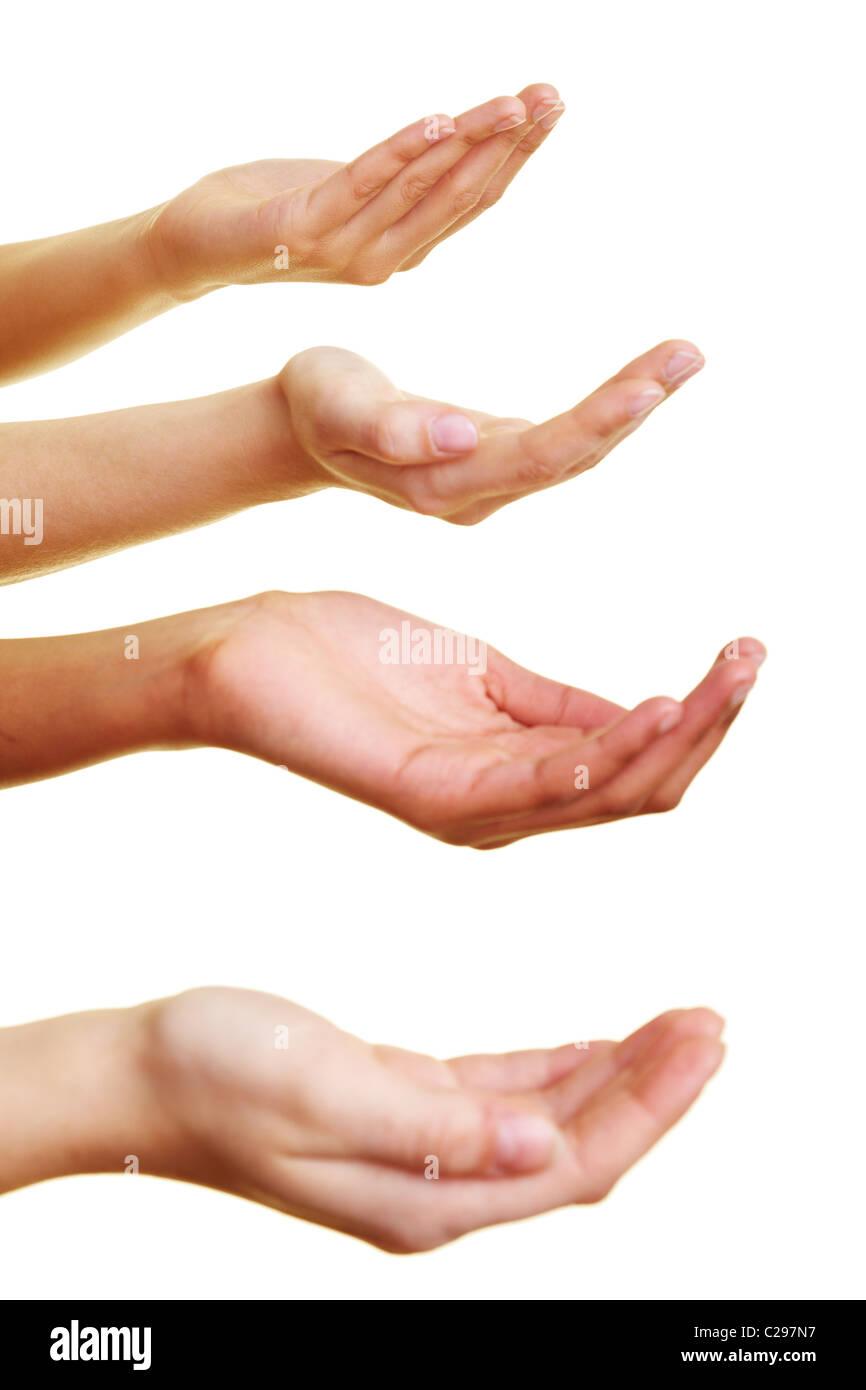 Vier Hände, um eine Spende bitten Stockbild
