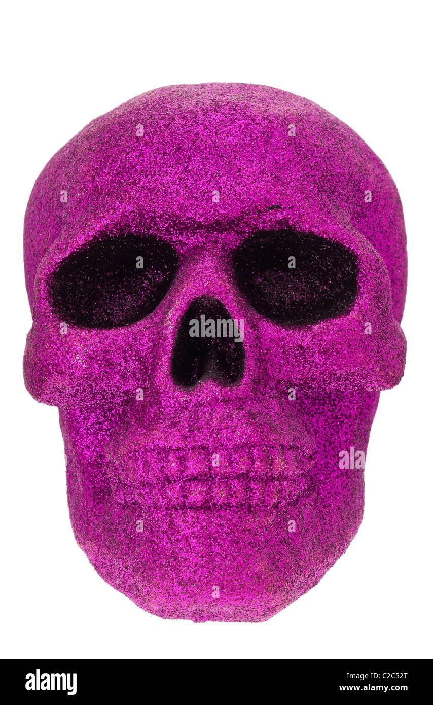 Schädel in lila Glitzer bedeckt Stockbild