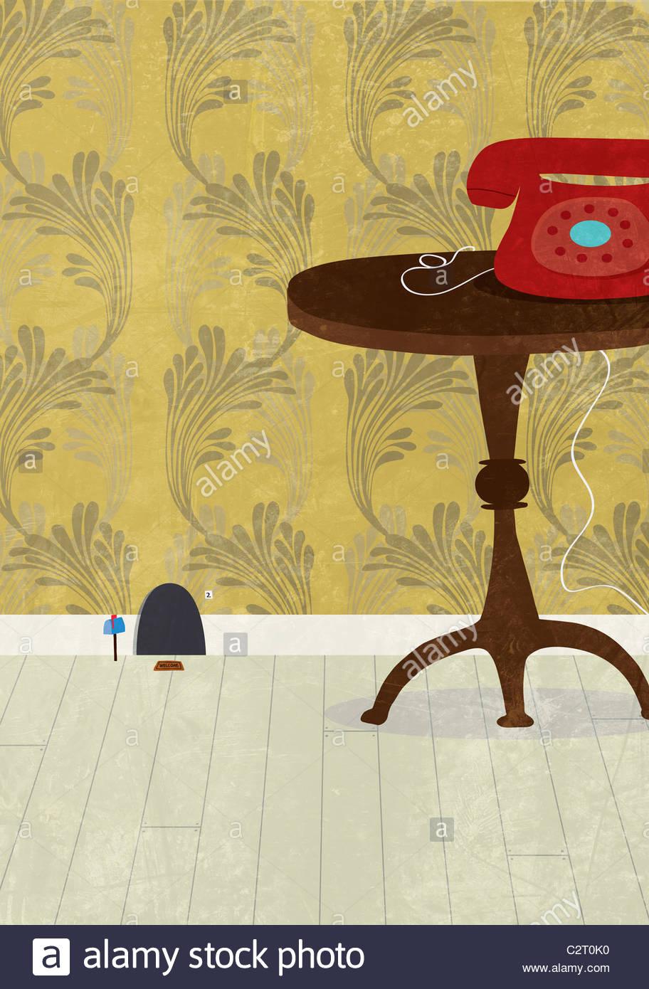 Mauseloch neben Tisch und Telefon Stockbild