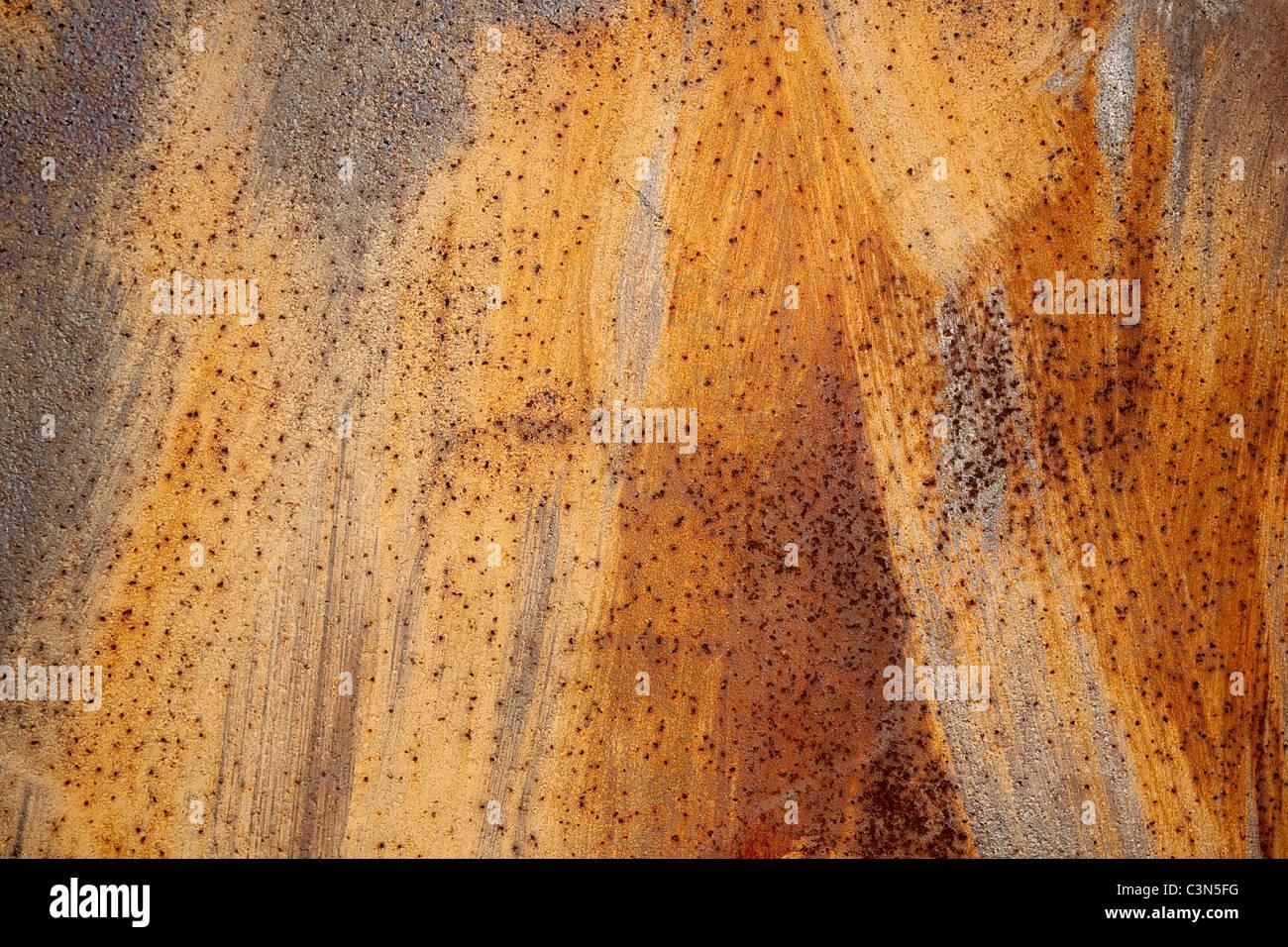 Fotografie zeigt einen rostigen Metall Hintergrund mit Scrachted Oberfläche. Stockbild