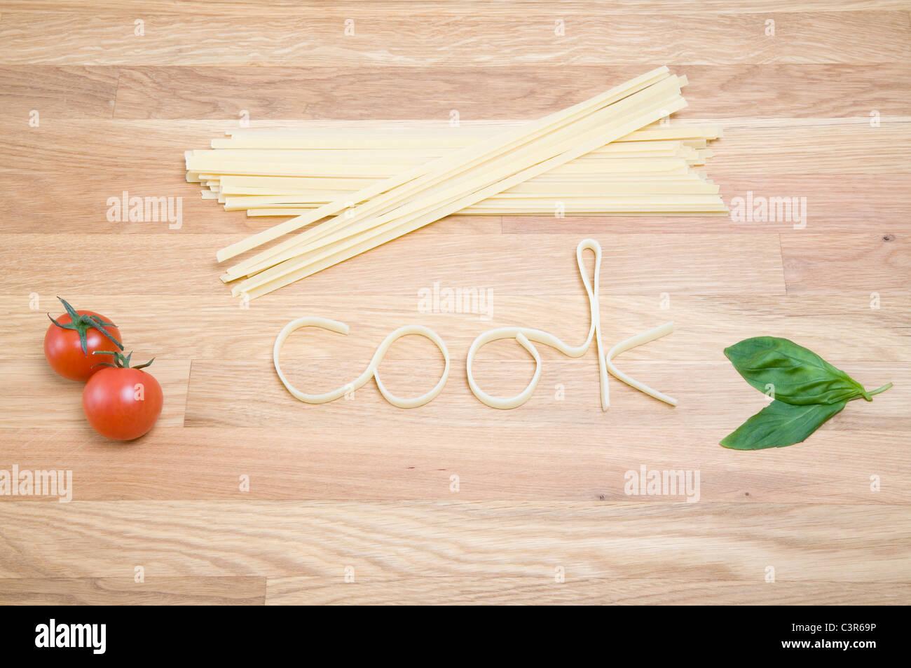 Nudeln buchstabieren des Wort-Kochs Stockbild