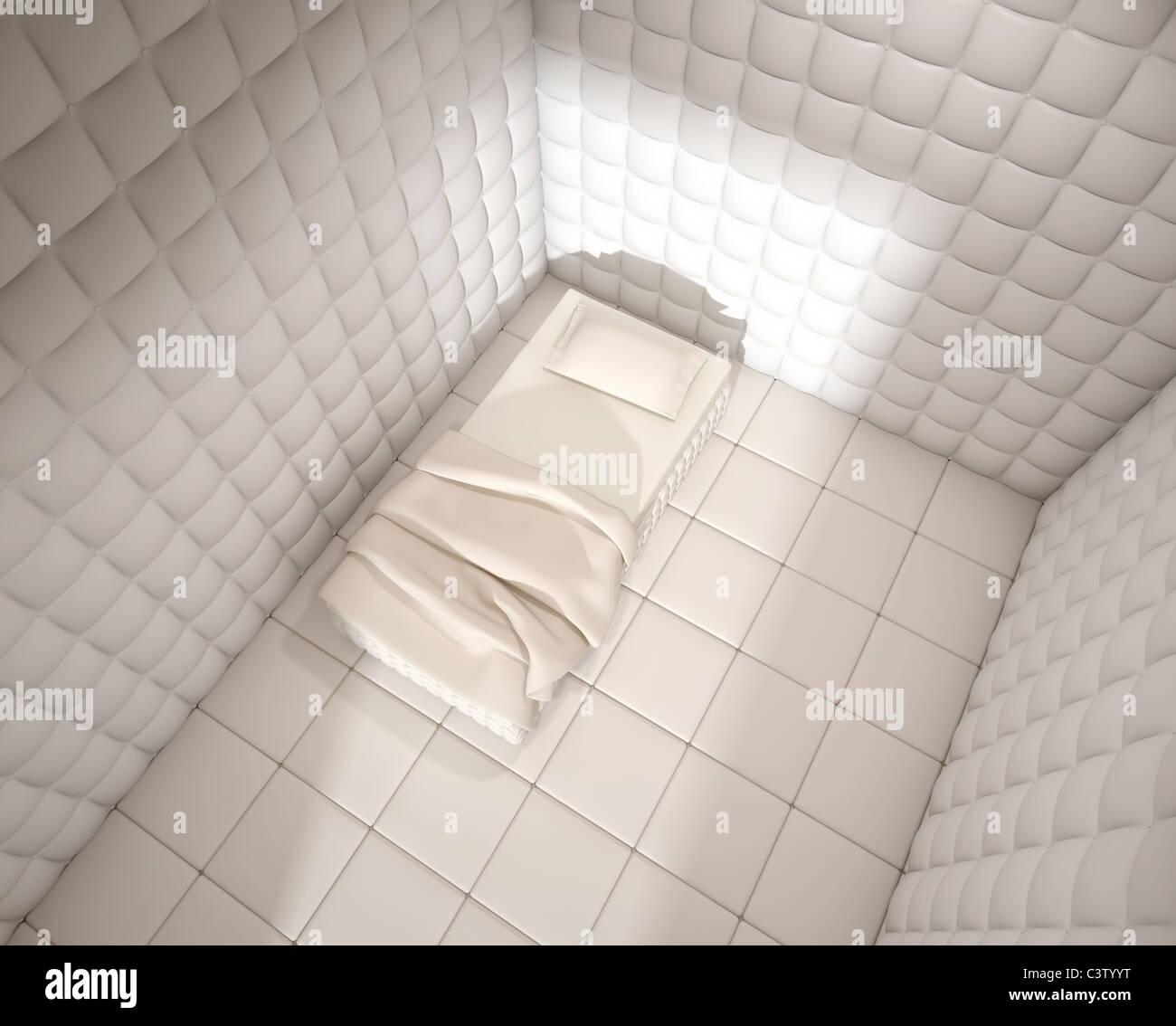 psychiatrischen Klinik gepolstert Zimmer mit einem Einzelbett von oben gesehen Stockfoto