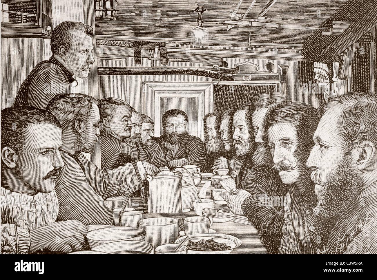 Nansen, stehend links, spricht zu den zwölf Männern seines Teams in der Küche der Fram während Stockbild