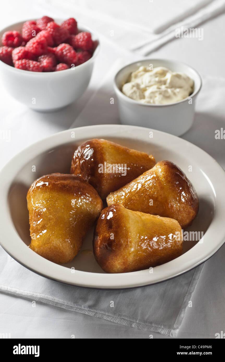 Rum Babas dessert Stockbild