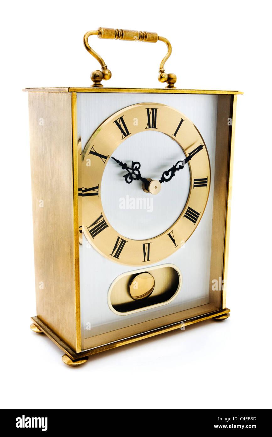 Gold Carrige Uhr isoliert auf weiss Stockbild