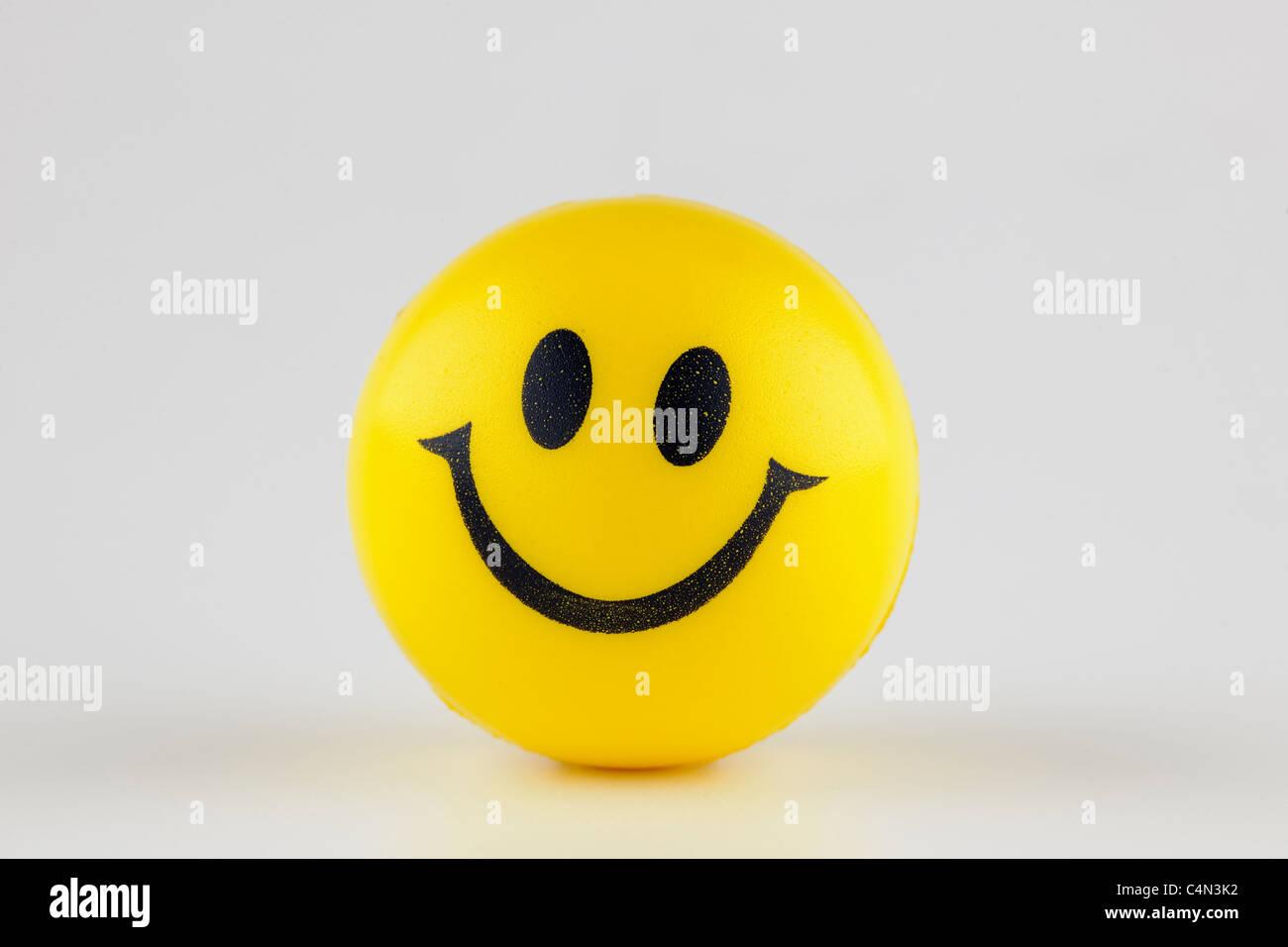 Gelber Smiley Gummiball Stockbild
