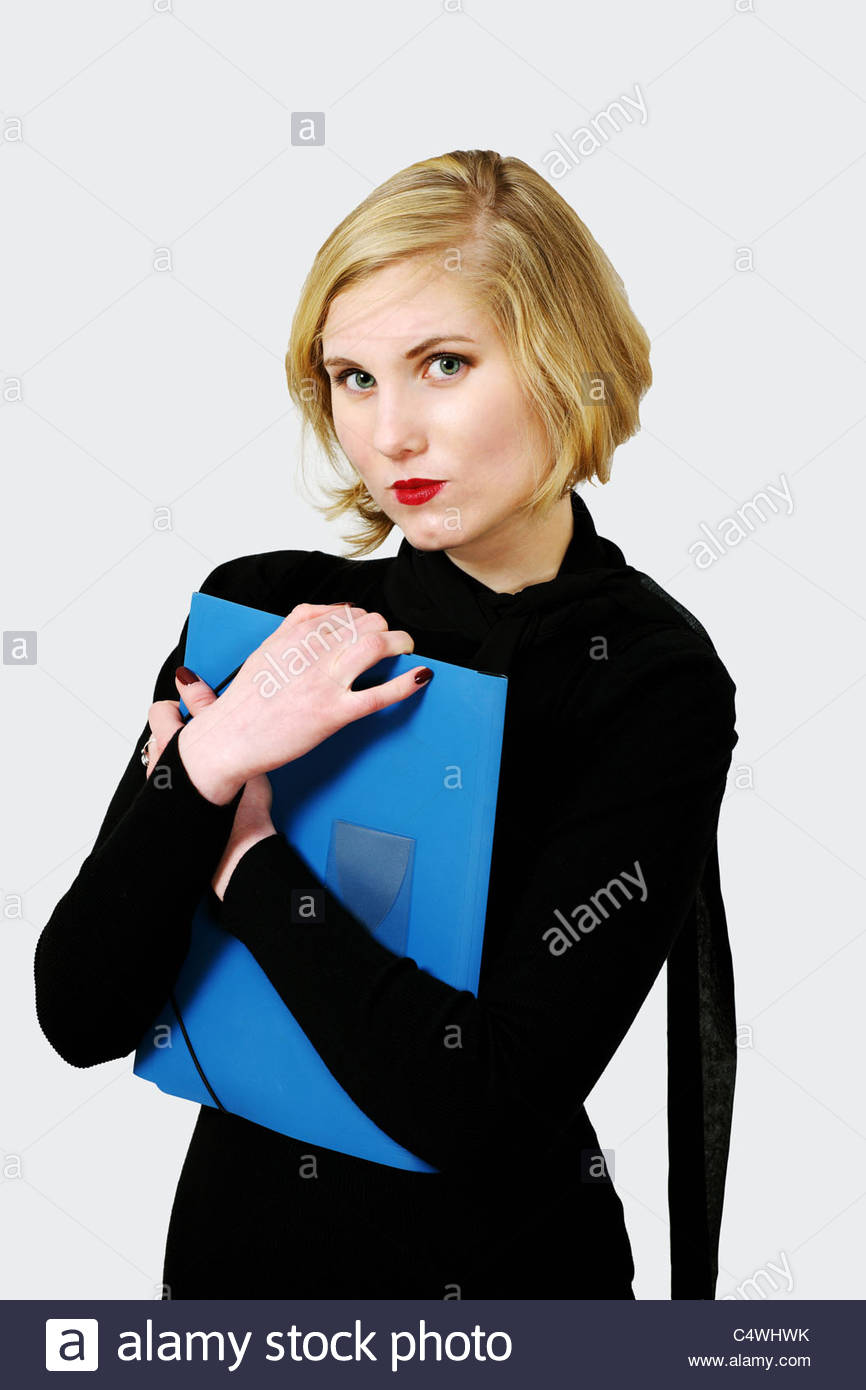 Anspruchsvolle weiblich halten Datei oder Dokument Stockbild