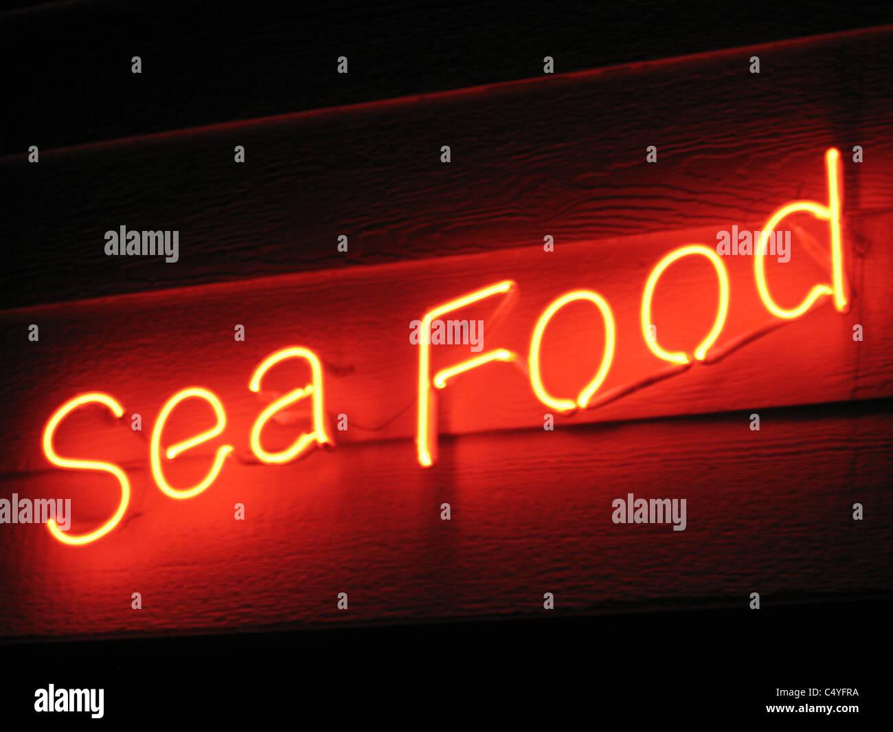 Leuchtreklame - Meeresfrüchte Stockbild