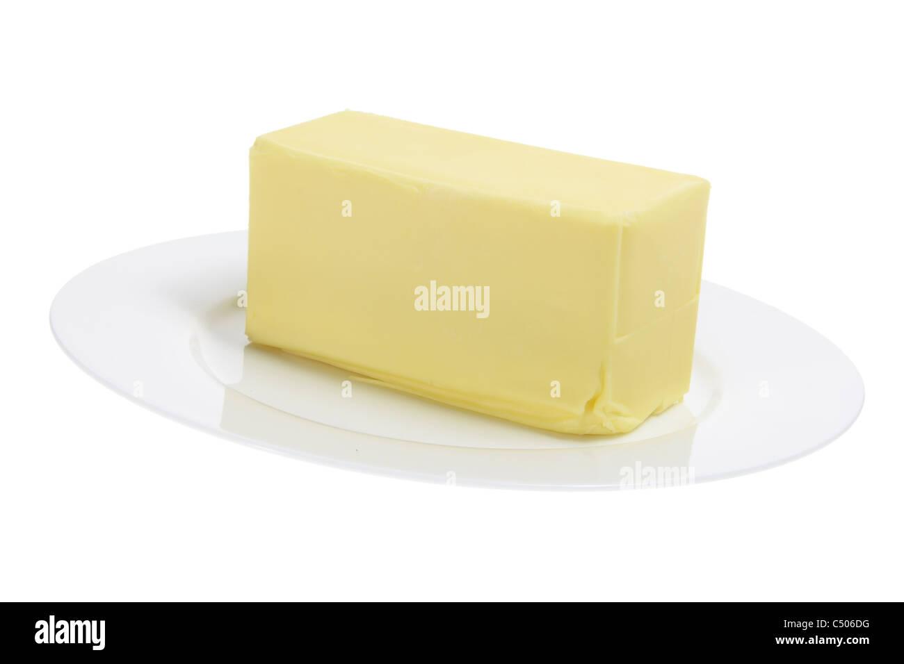 Butter auf Platte Stockfoto