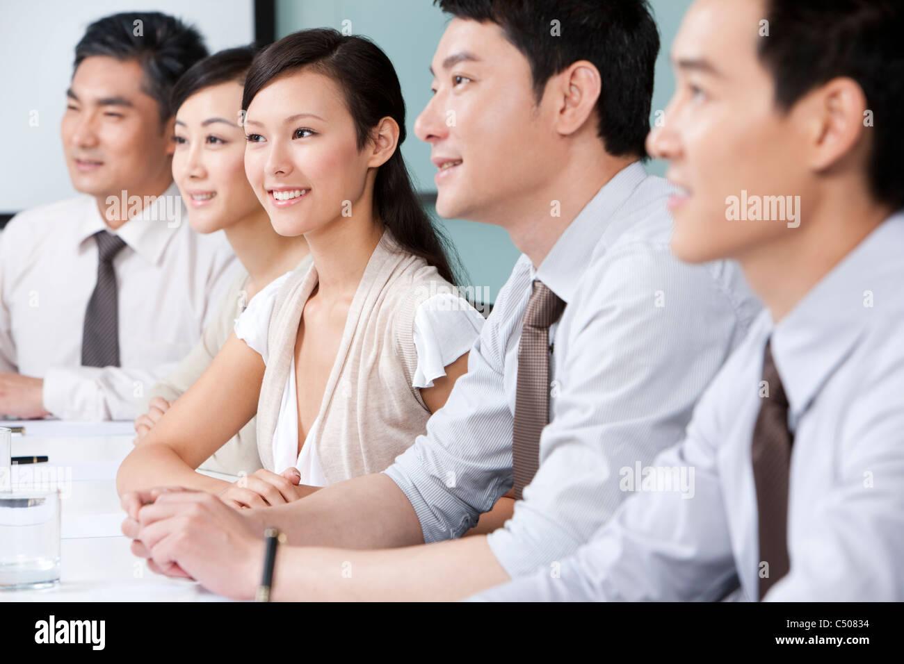 Business-Team lauschte Stockfoto