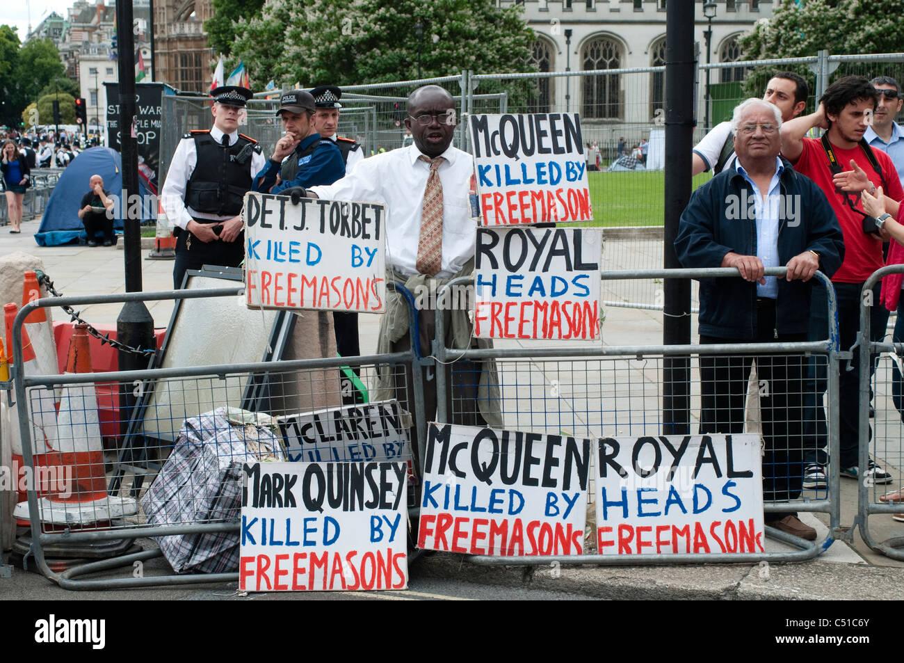 Parlament quadratische Demonstrant. McQueen getötet von Freimaurern, London, UK Stockbild