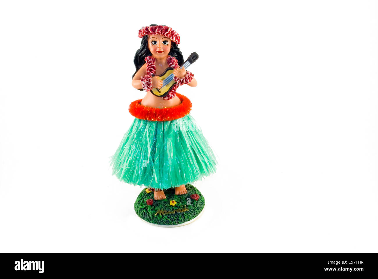 Ein traditioneller Hula Puppe Schmuckstück isoliert auf einem weißen Hintergrund. Stockbild