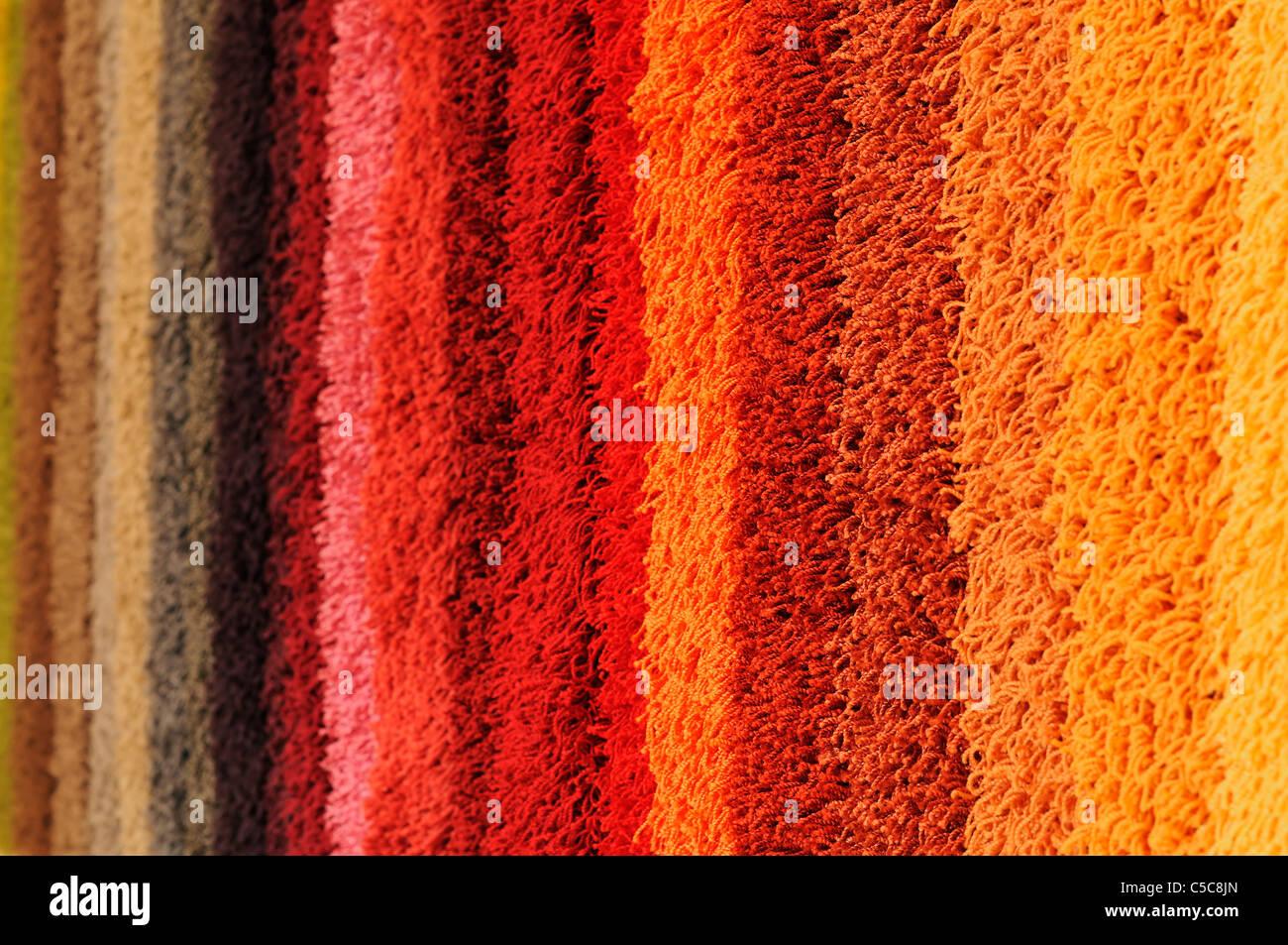 Farbspektrum von Teppich Proben Stockbild