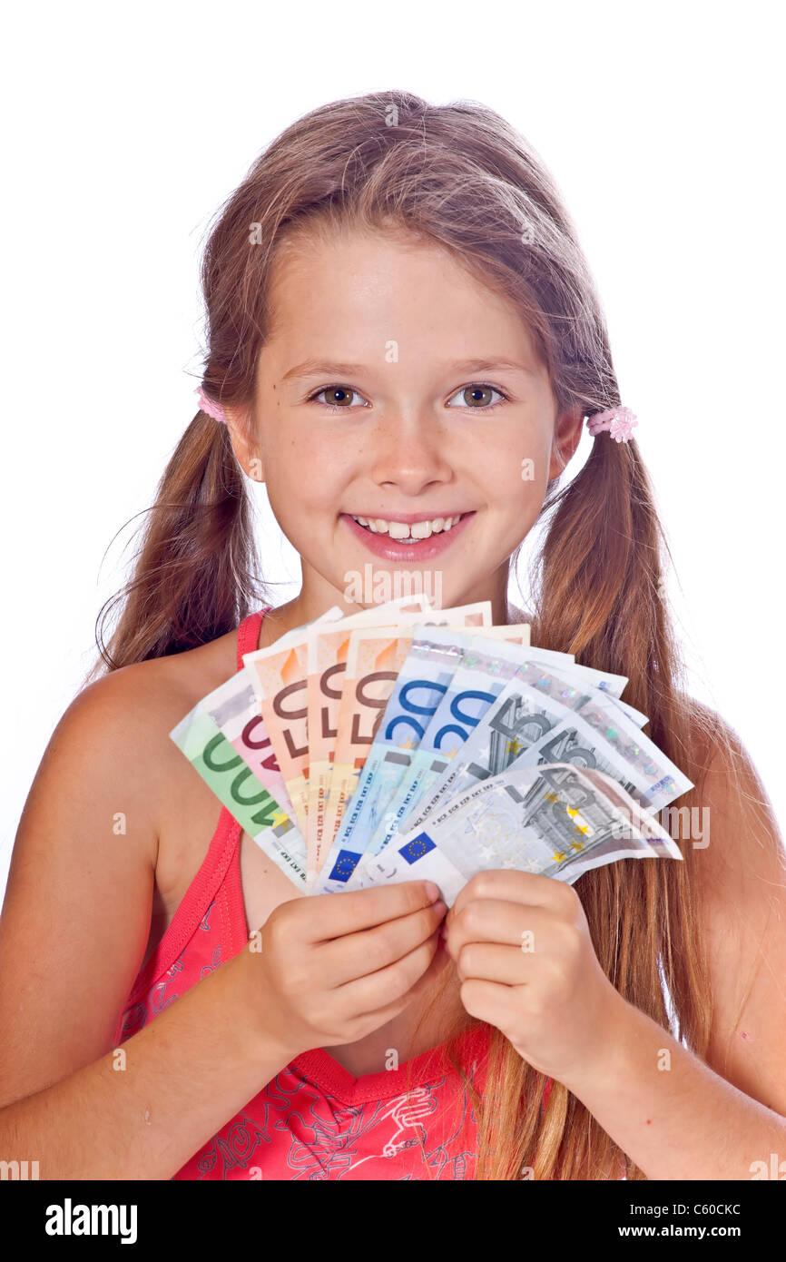 acht Jahre altes Mädchen zählt ihr Geld Stockbild
