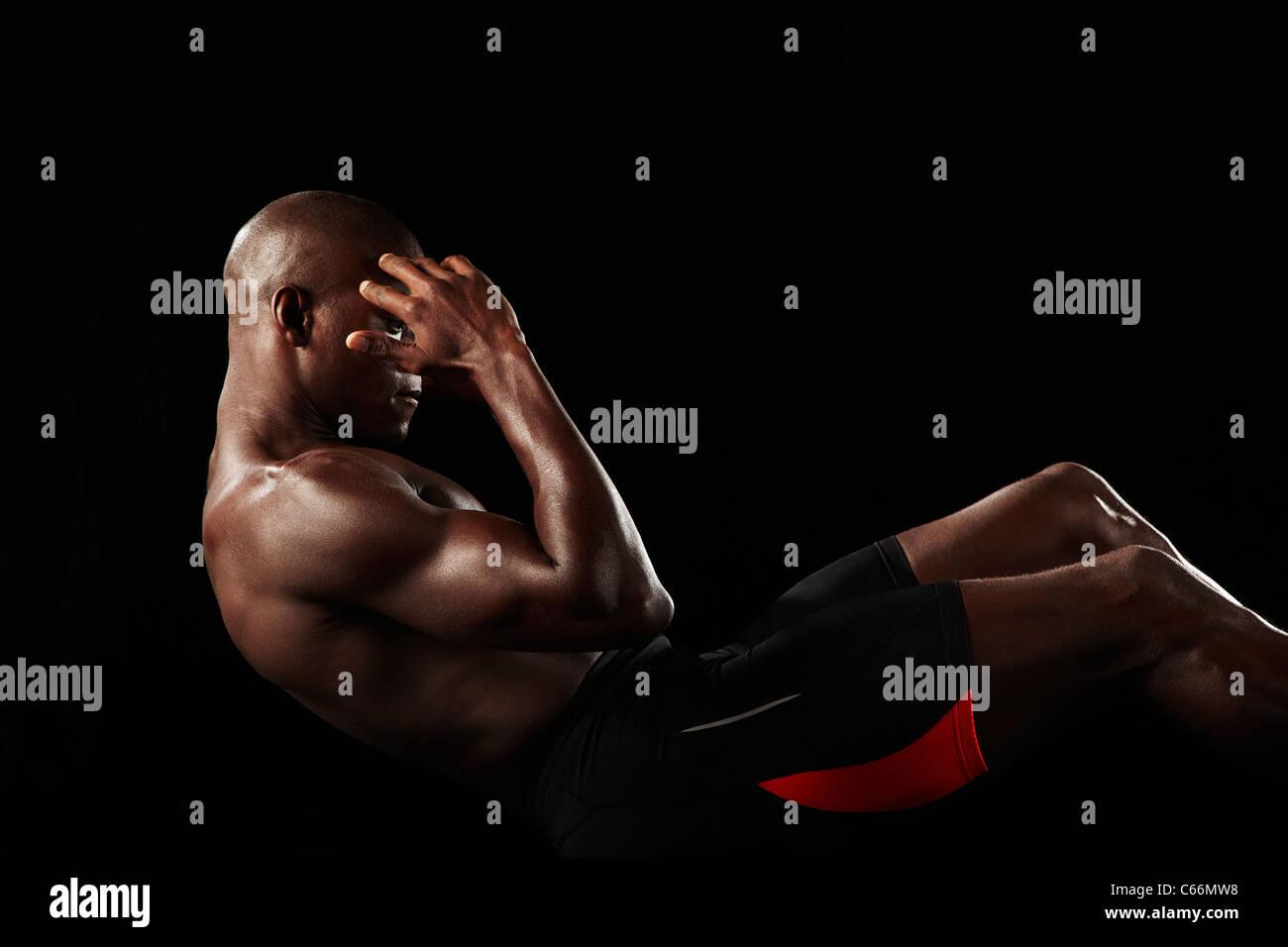 Athlet Sit Stockbild