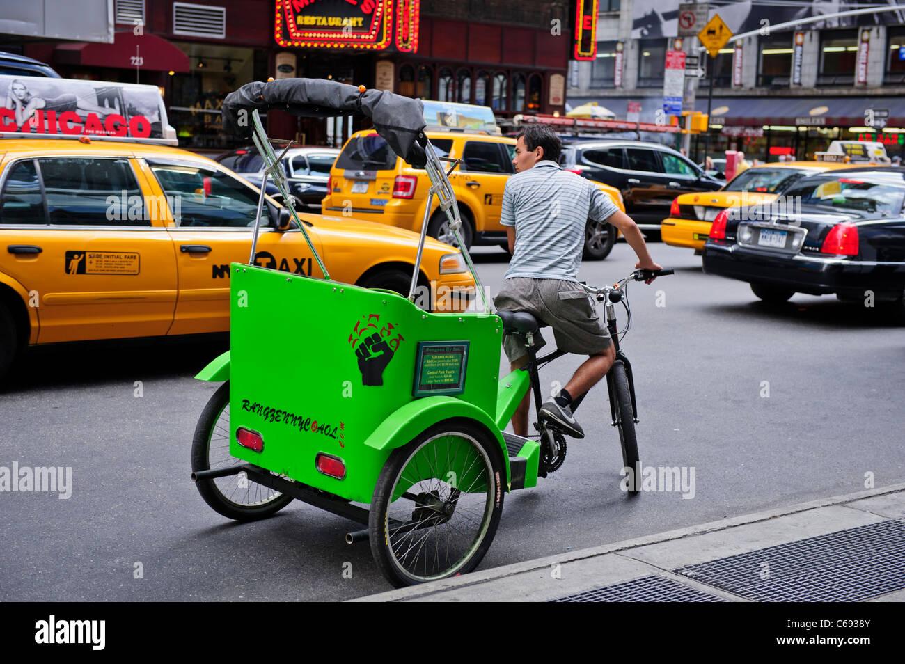 Rikscha, Times Square, New York City, USA. Stockbild