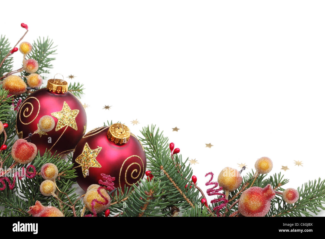 Weihnachtsbilder Mit Kugeln.Tannenzweigen Beeren Und Kugeln Für Weihnachten Grenze Stockfoto
