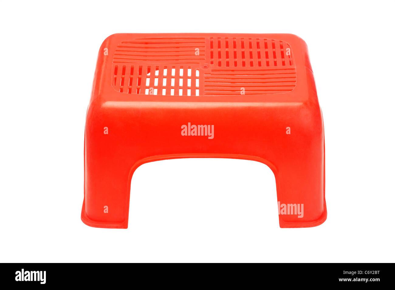 Mini rote Kunststoff Hocker auf weißem Hintergrund Stockbild