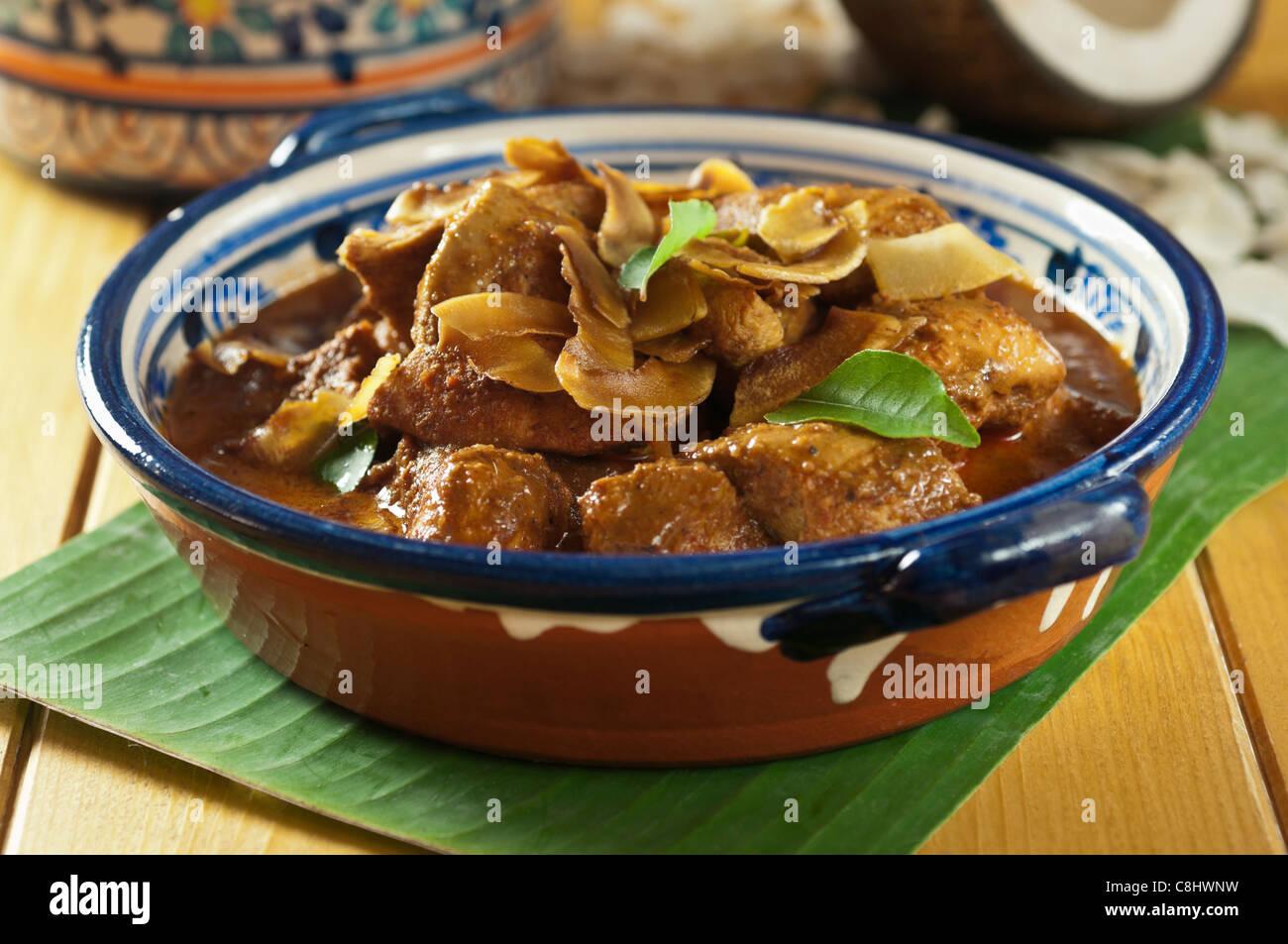 Chicken Xacuti mit Kokosreis. Westindien Essen Stockbild