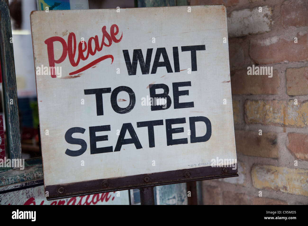 Please Wait To Be Seated Stockfotos Please Wait To Be Seated