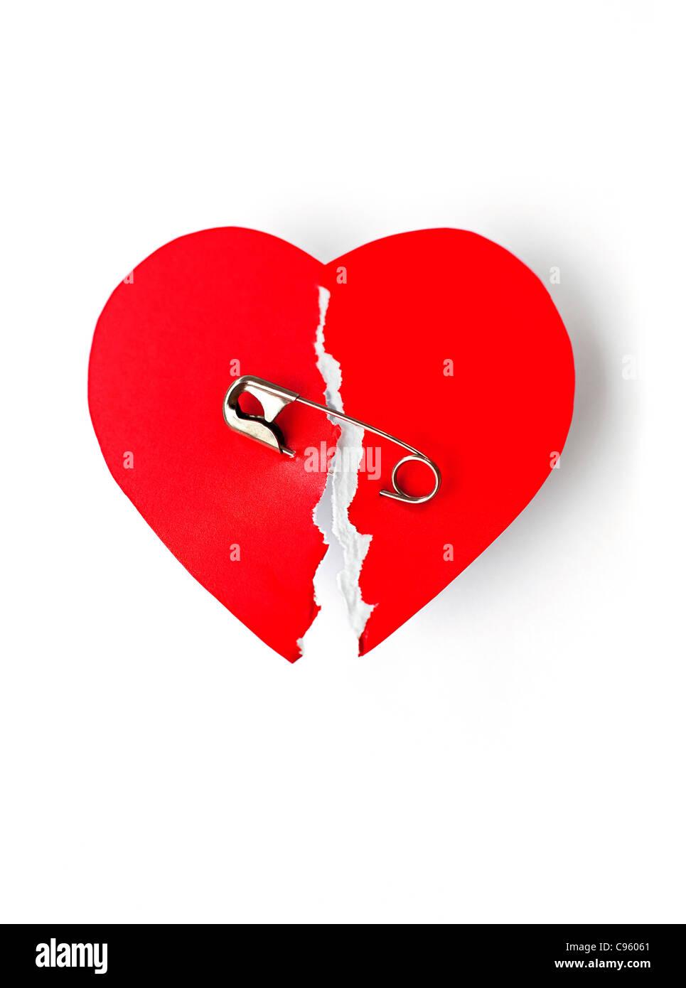 Ein gebrochenes Herz Konzeptbild ausbessern. Stockbild
