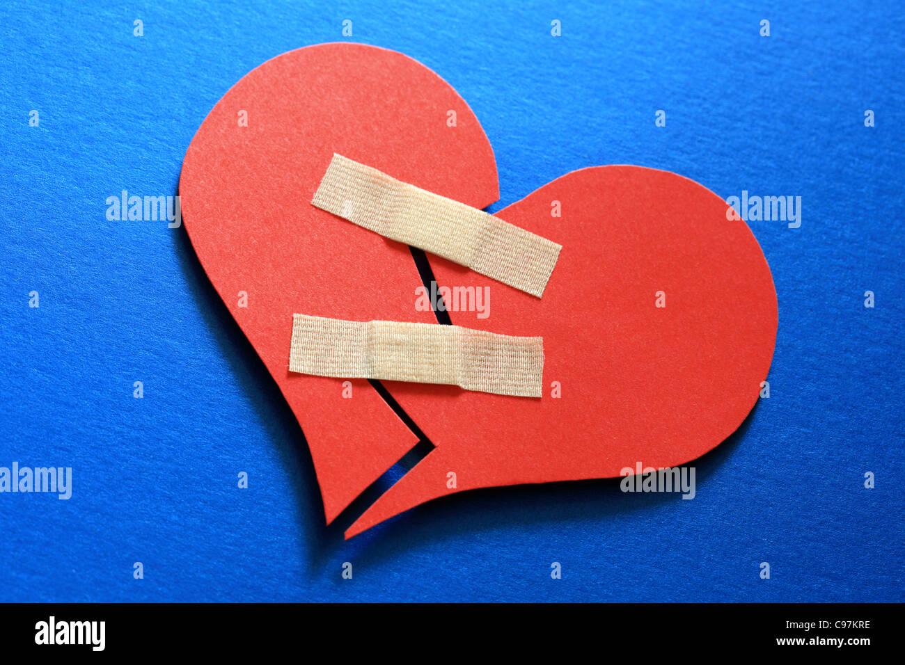 Ein gebrochenes Herz zu Flicken Stockbild