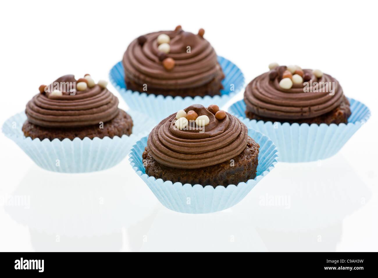 Cupcakes Vier Schokokuchen Mit Brauner Buttercreme Verwirbelt Und