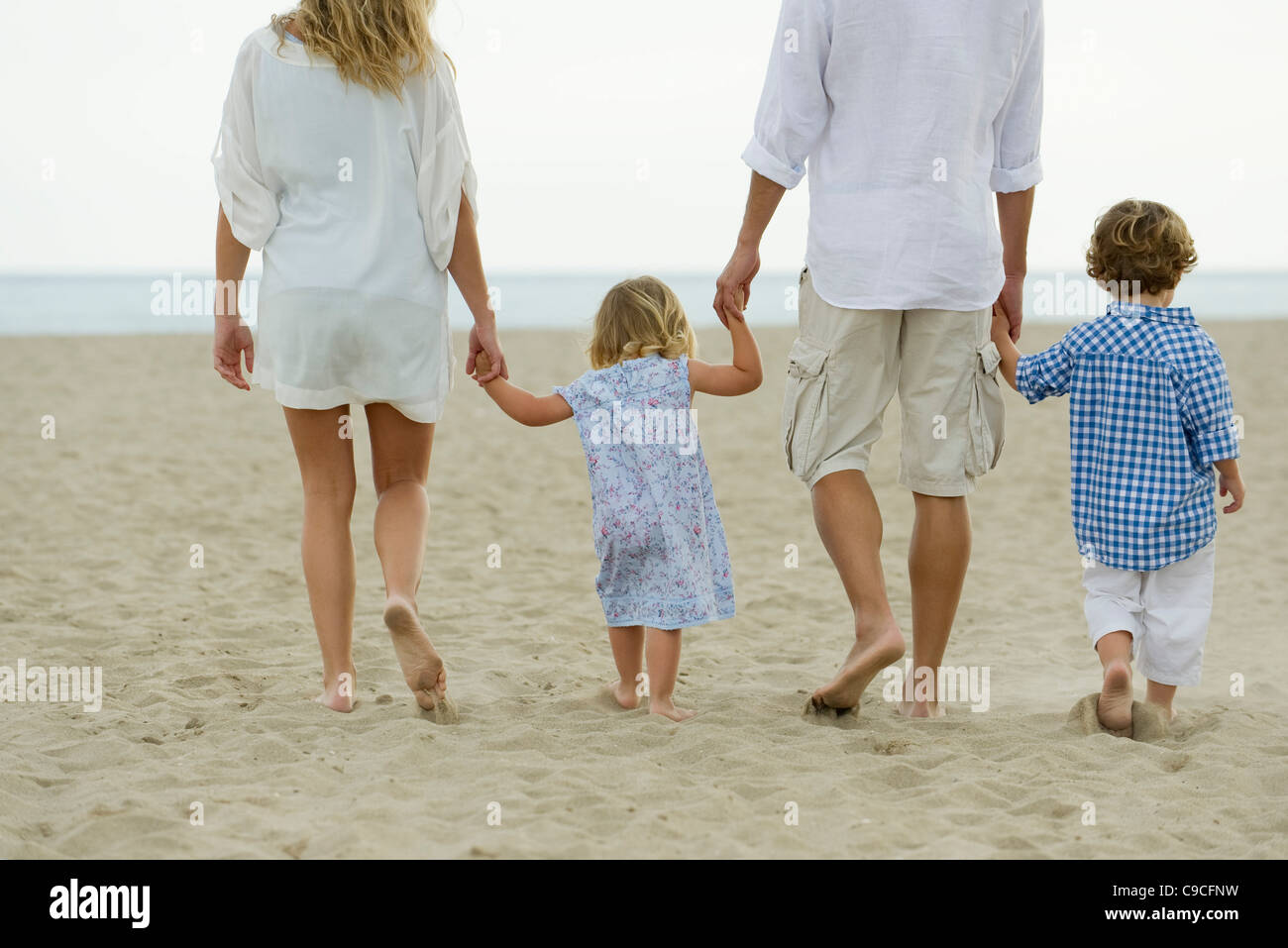 father son walking hand in stockfotos father son walking hand in bilder alamy. Black Bedroom Furniture Sets. Home Design Ideas