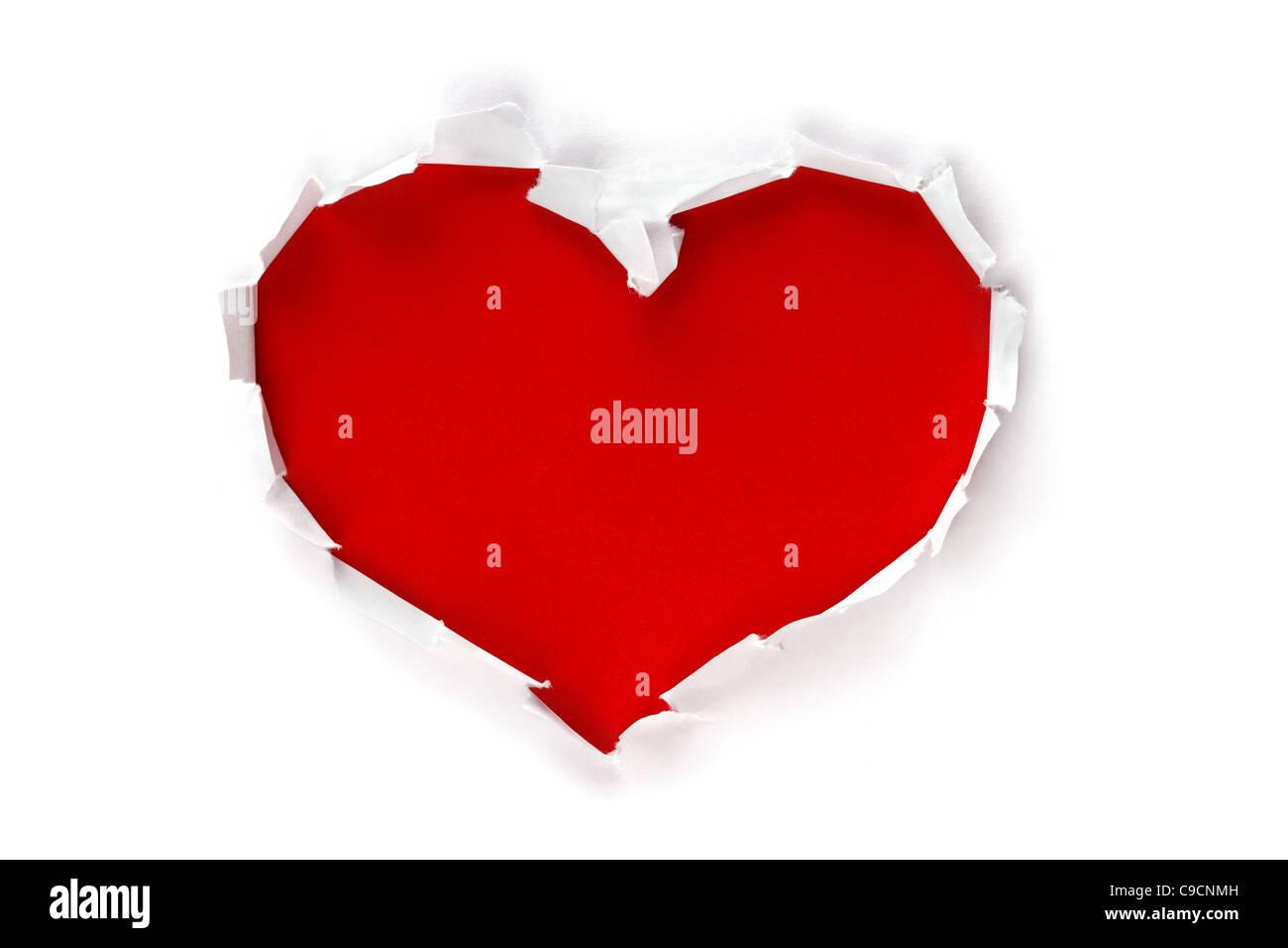 Herz-Form-Loch durch Papier Stockbild