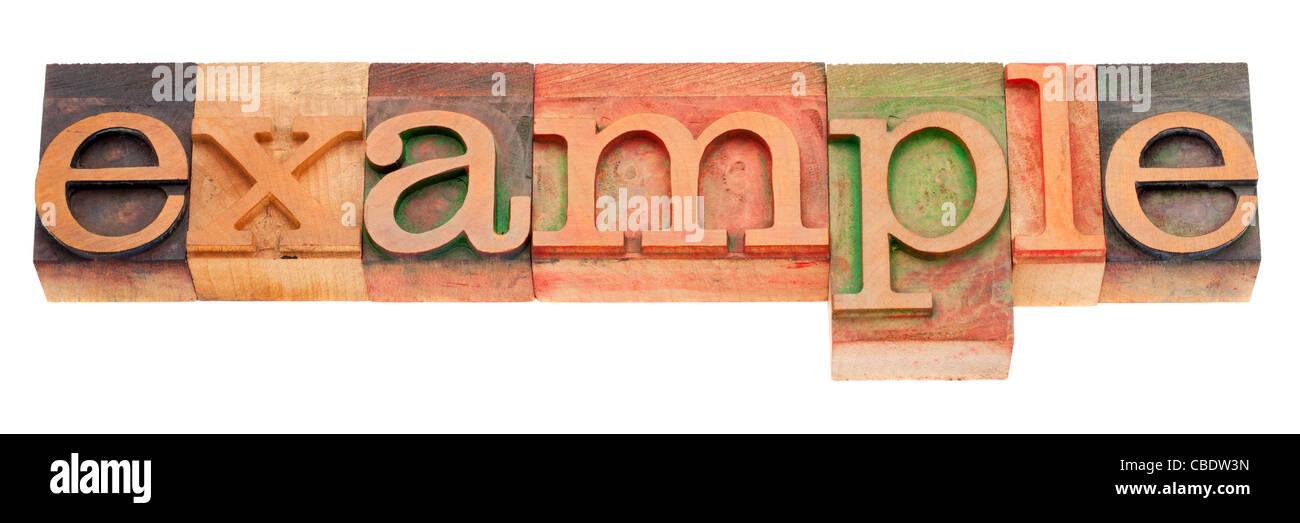 Beispiel-Wort in Vintage Holz Buchdruck Druckstöcken, befleckt durch Farbe Tinten, isoliert auf weiss Stockbild