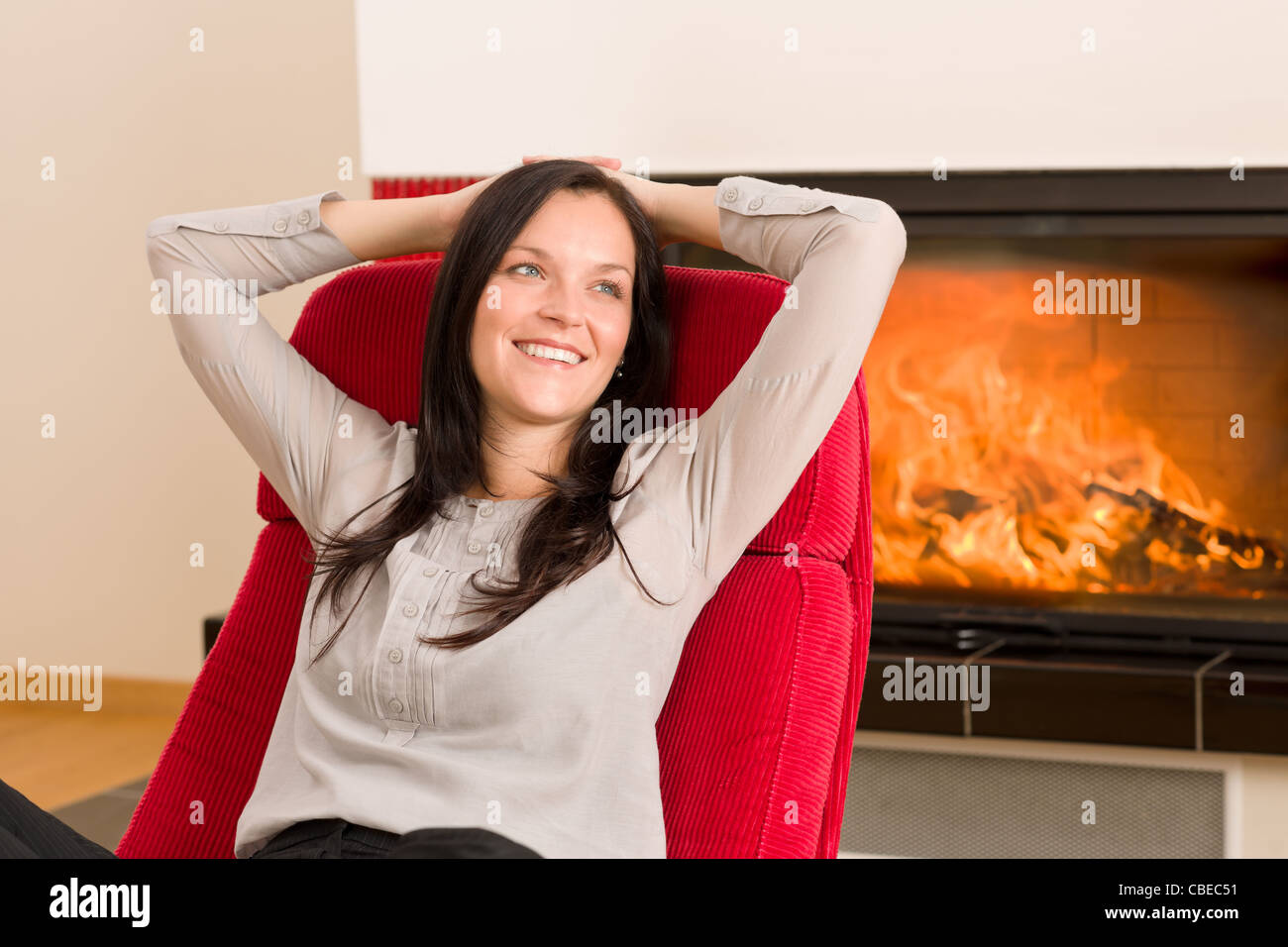 woman relax fireplace stockfotos woman relax fireplace bilder alamy. Black Bedroom Furniture Sets. Home Design Ideas