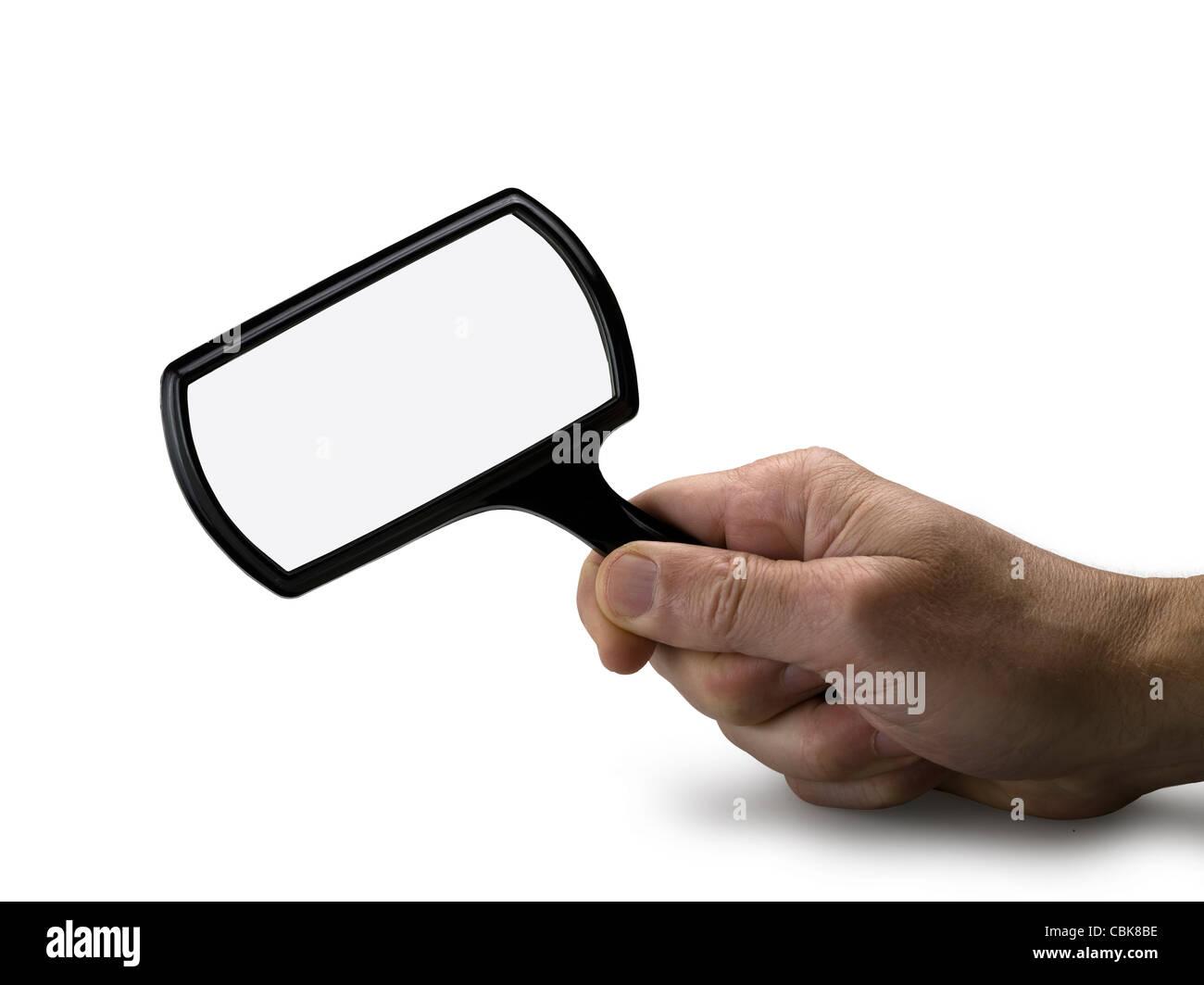 Hand mit Lupe isoliert (Clipping-Pfad) + Pfad für das Glas Stockfoto