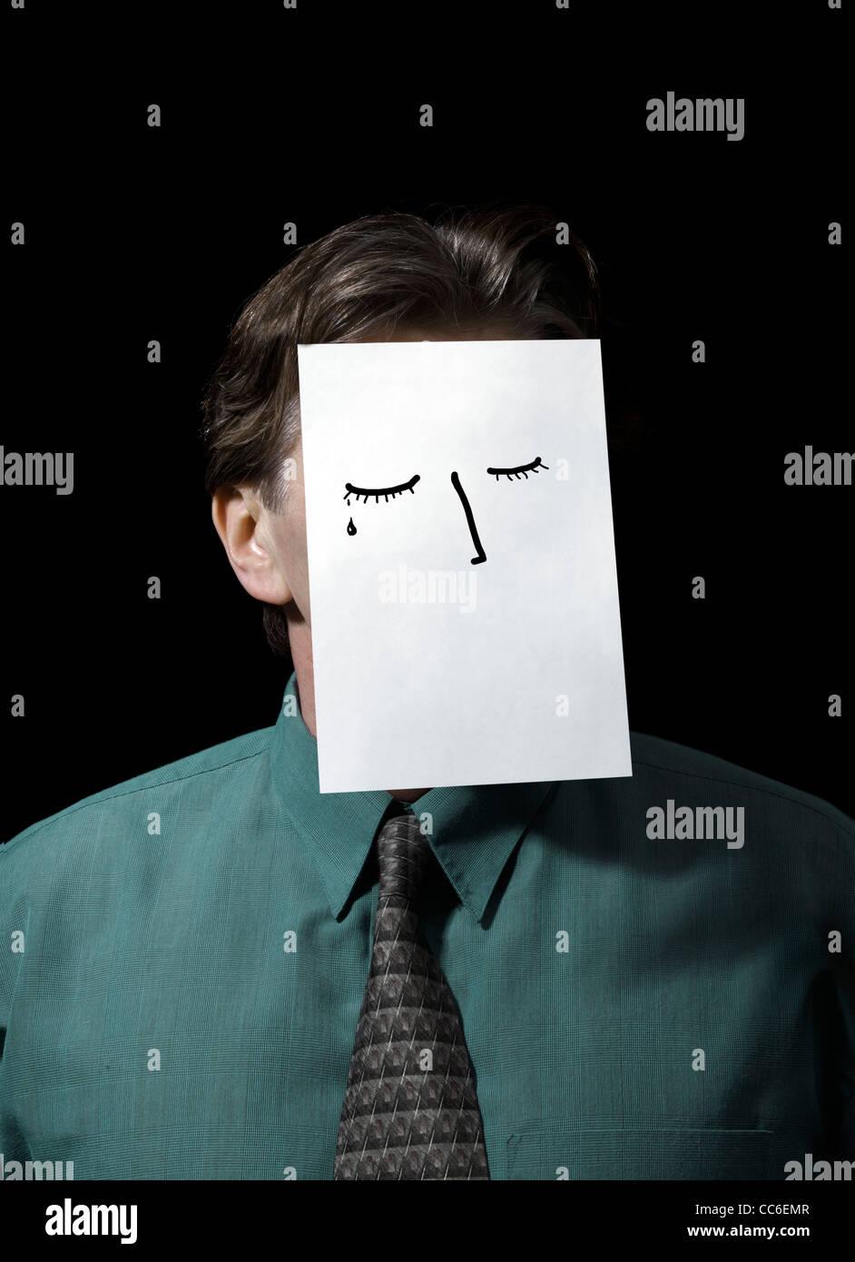 Geschäftsmann mit über Gesicht Zeichnung auf Papier Stockbild