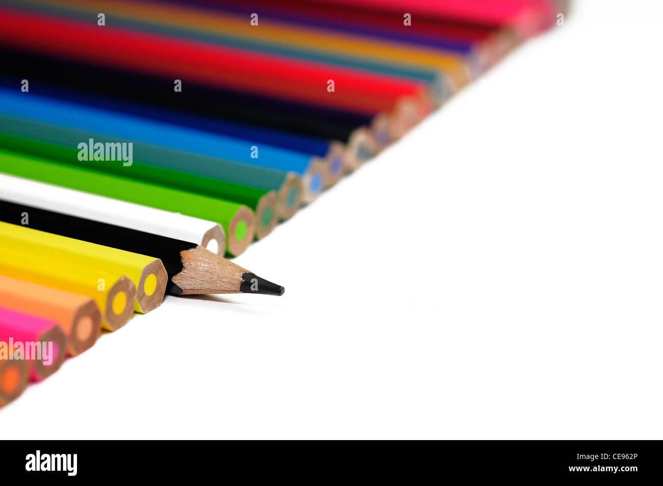 Buntstifte und eine unverwechselbare schwarze, schwarze Schafe Stockbild